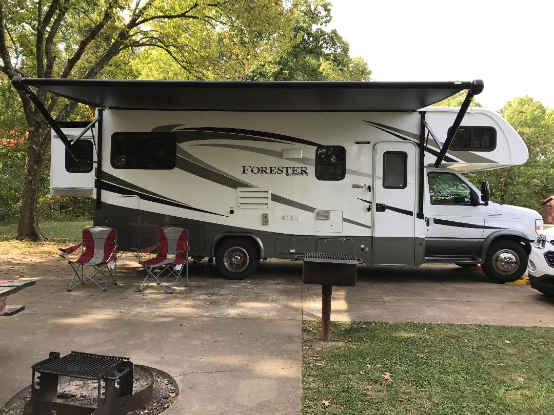 Side view with entry, awning out, awning is lighted, exterior sound, etc.  View with unit fully extended .. Forest River Forester 2017