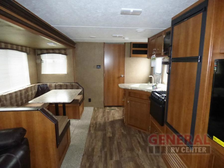 Facing queen bedroom with door. Kitchen dining room also makes into a bed. Full stove top and microwave. Refrigerator and freezer. Outdoor kitchen as well. Plenty of room for food and drink. Two coolers available on the deck outside with full grill.   . AVENGER 27DBS-P 2017