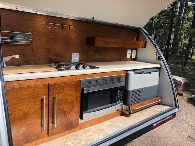 Hatch includes outdoor kitchen consisting of freezer/fridge, microwave, propane stove, sink, and 5 gallon water tank. . Little Guy Tag Max XL Outback 2018