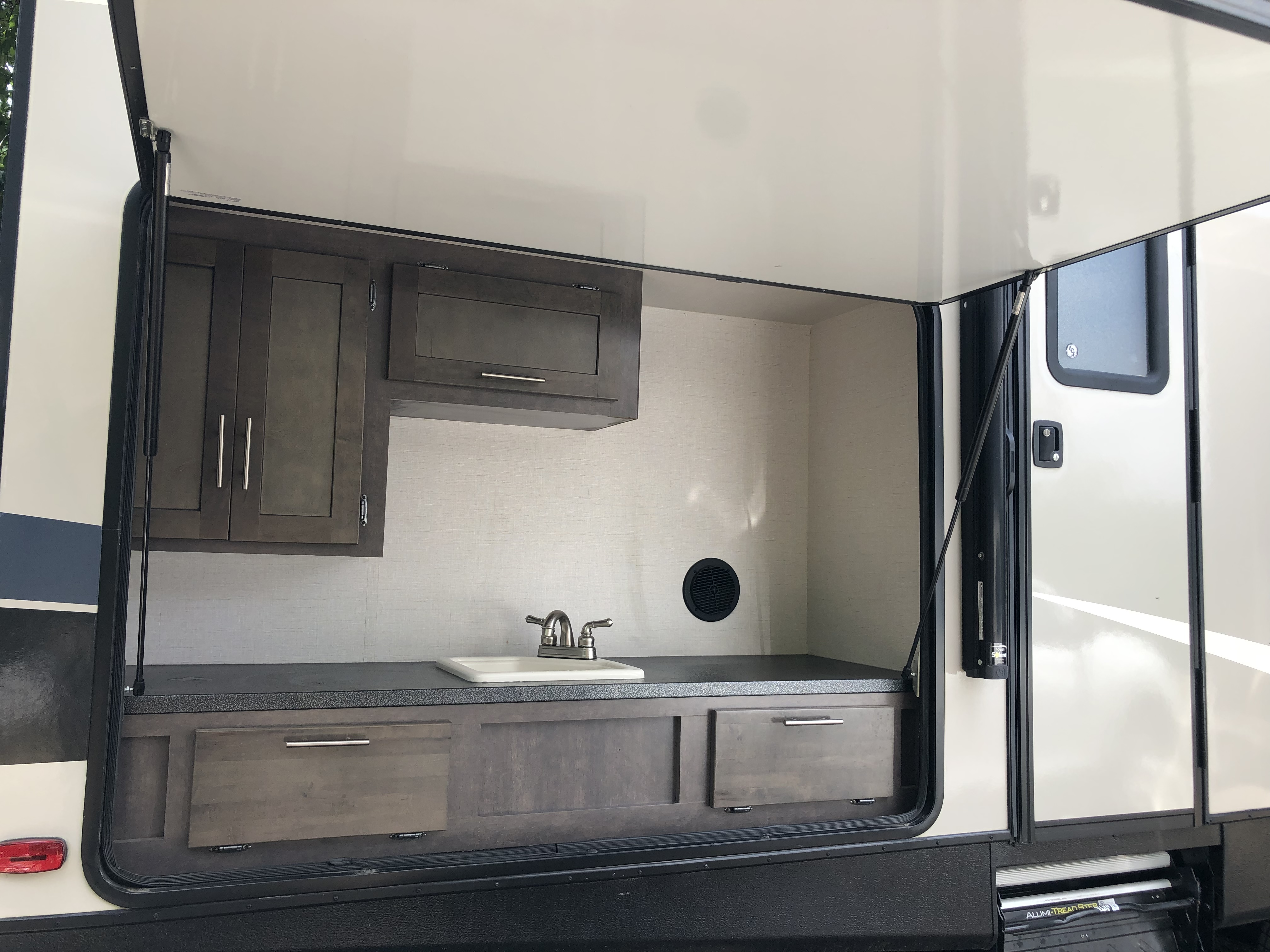Outdoor kitchen offers sink and additional storage . Crossroads Sunset Trail Super Lite 2017