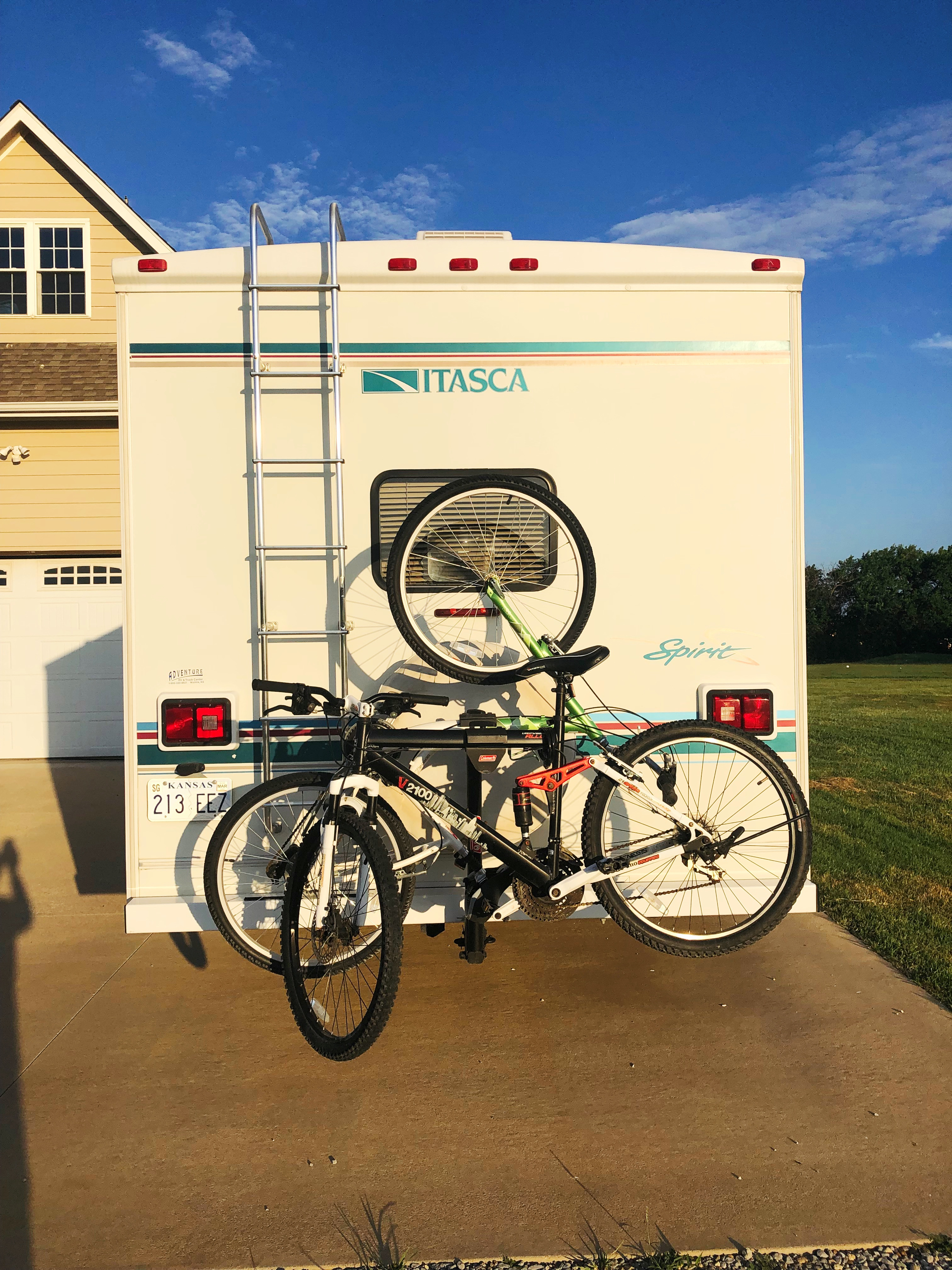 Example of bike rack loaded.  Bike rack is an ad on; bikes are not included. One bike mounts upside down.  We will include a chair rack on the ladder to hold chairs if you'd like to use it. . Itasca Spirit 2000
