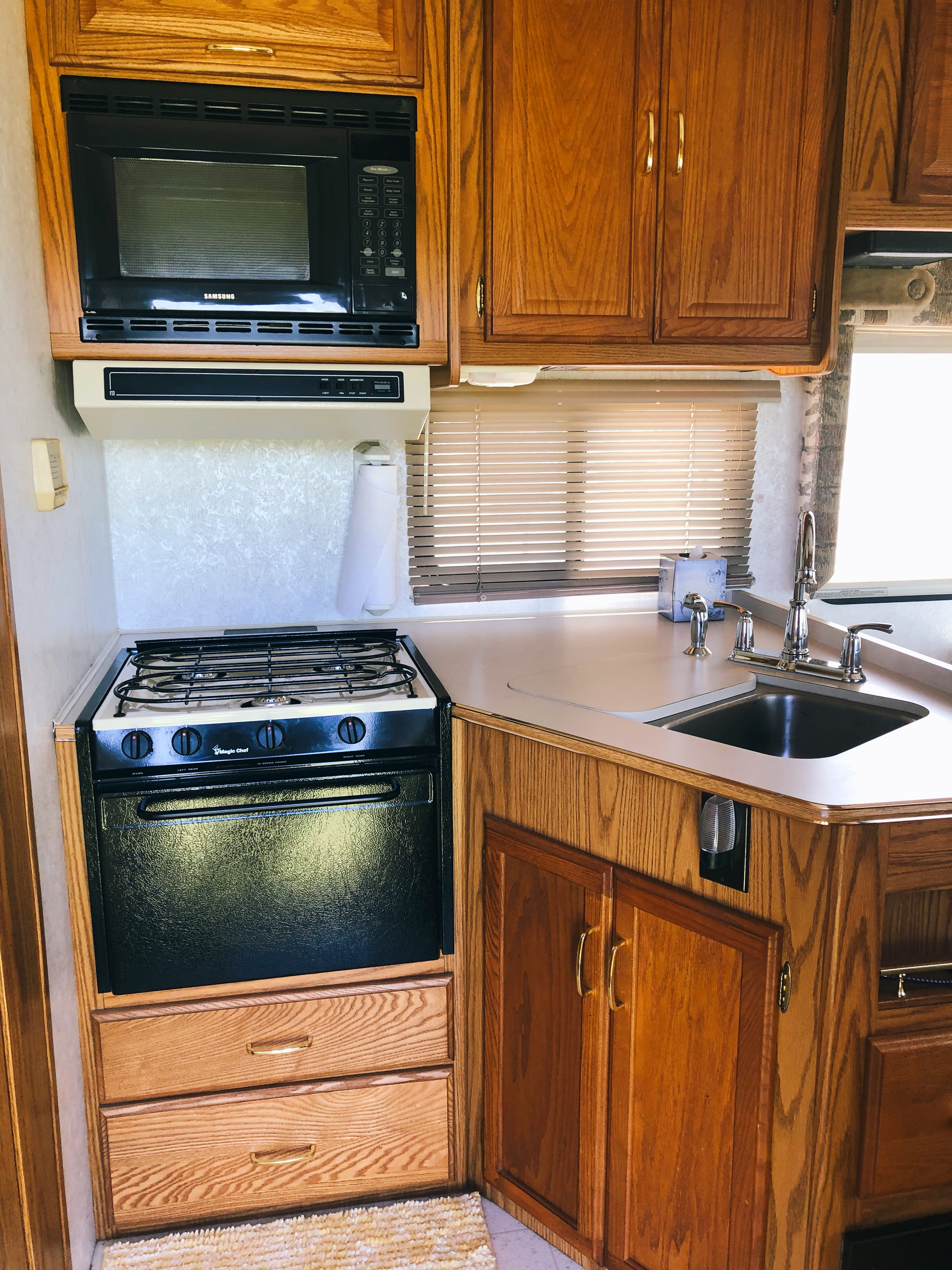 With this three burner stove and oven you can make a large meal even if you're not grilling outside. Microwave is above the stove. . Itasca Spirit 2000