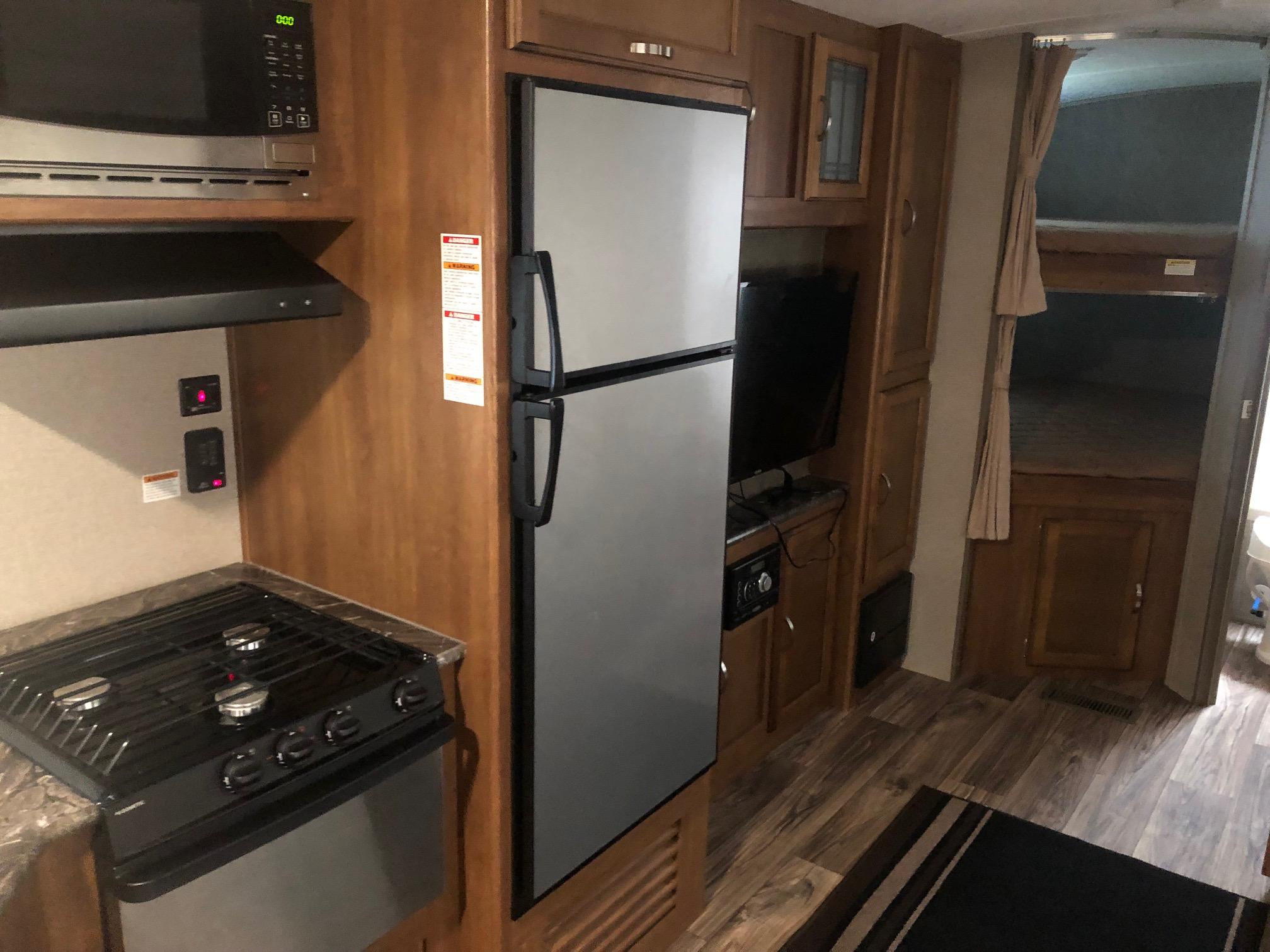 Stove/Oven, Microwave, and Large Fridge. Keystone Springdale 2018