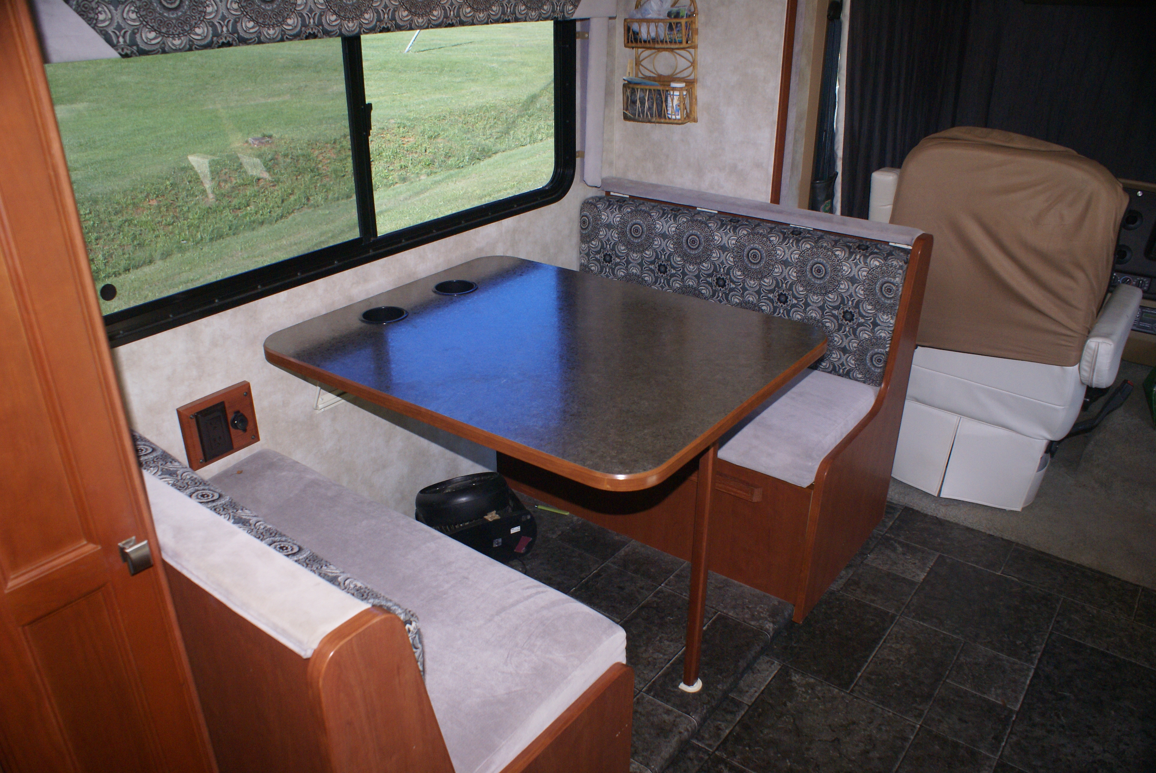 Dining Room/  2nd bed,  Very comfortable bed for the kids or house guests; or very large pets or elephants.  . Winnebago Vista 2013