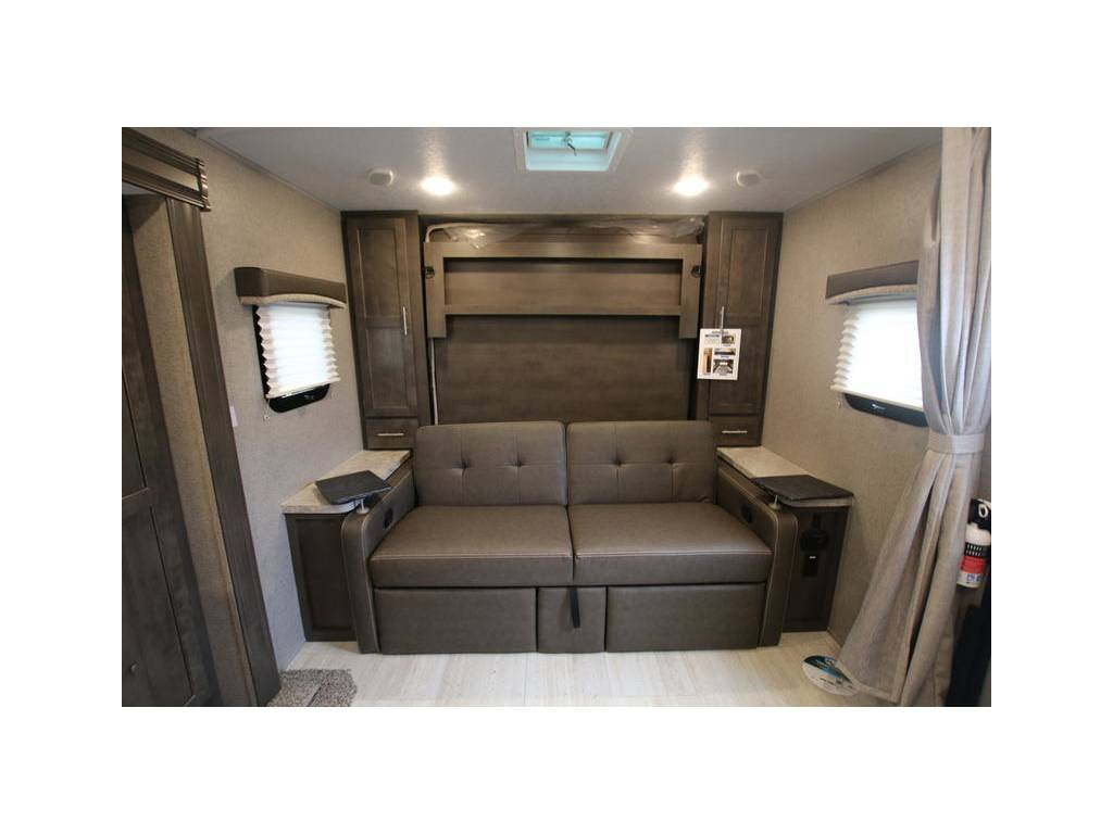 Couch with leg rests and work tables. Forest River Rockwood Mini Lite 2019
