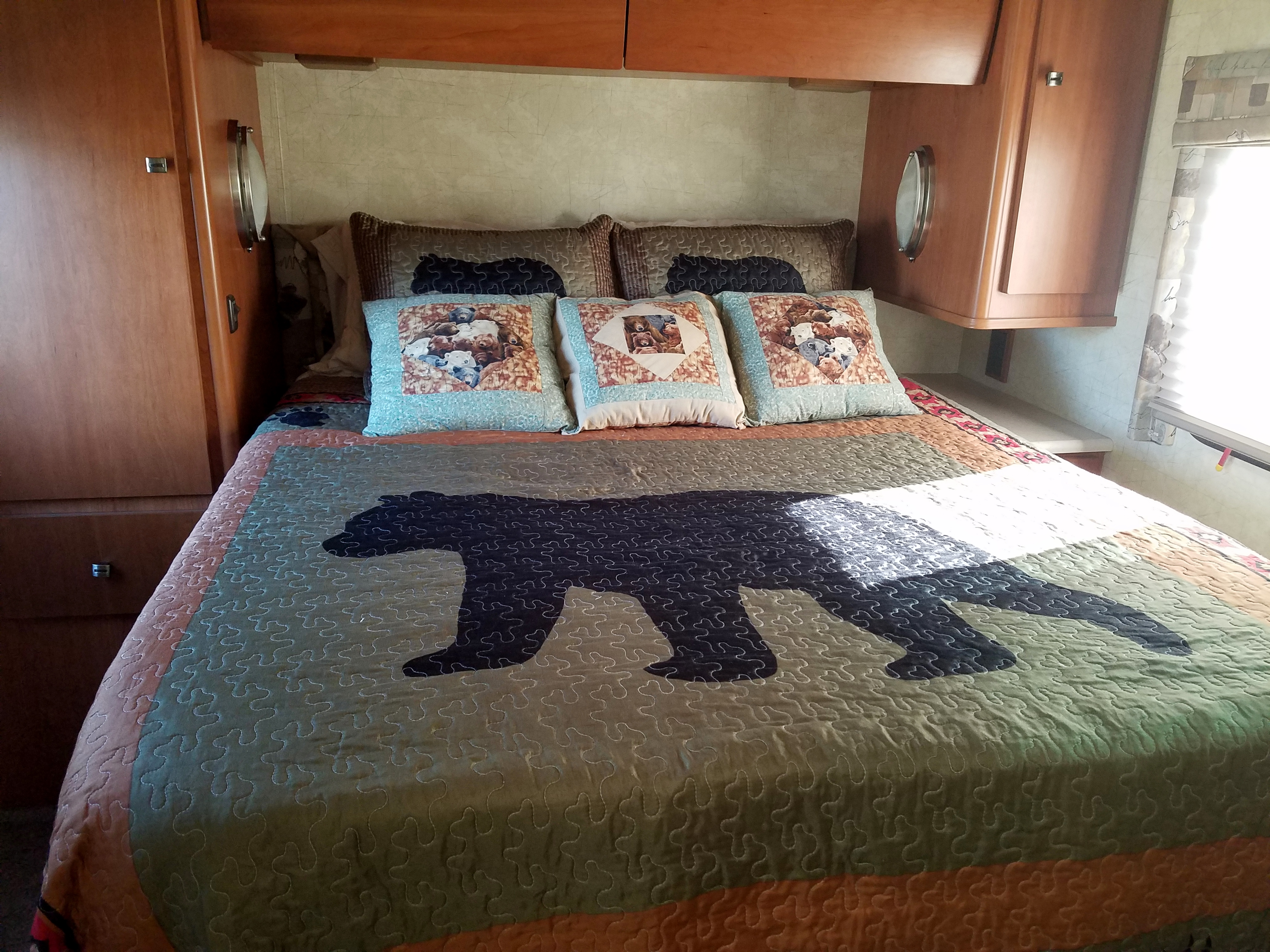Queen size bed with memory foam pad and pillows.  Campers say it is very comfortable.
