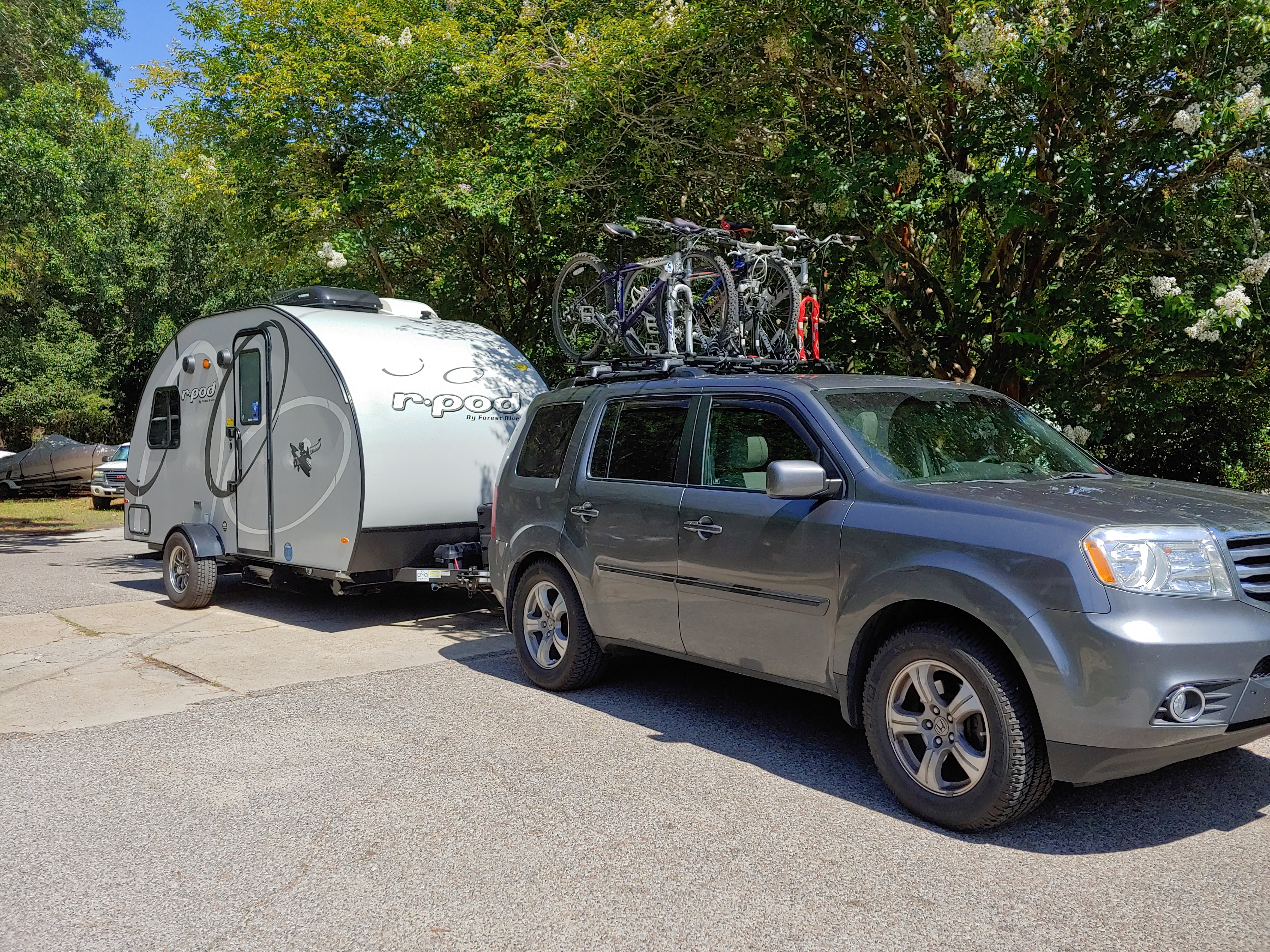 The pod on the go!  As a family of 4, we put 3 bikes on our car and one inside on a bunk.  The other side has a handy outdoor shower.. Forest River R-Pod 2020