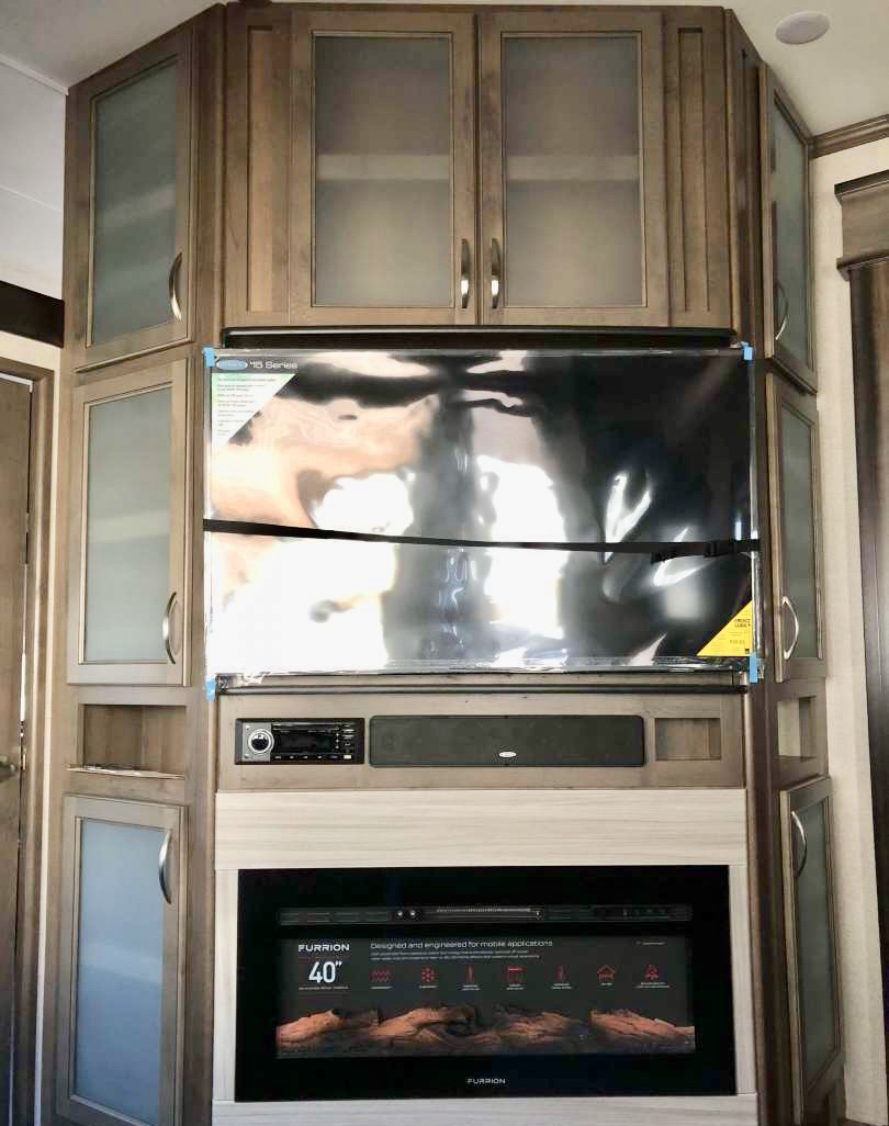 Main room TV, with radio/DVD player. There is also storage located all around the television. Beware the storage inside is not as big as ur kitchen cabinets. . Dutchmen Voltage 2019
