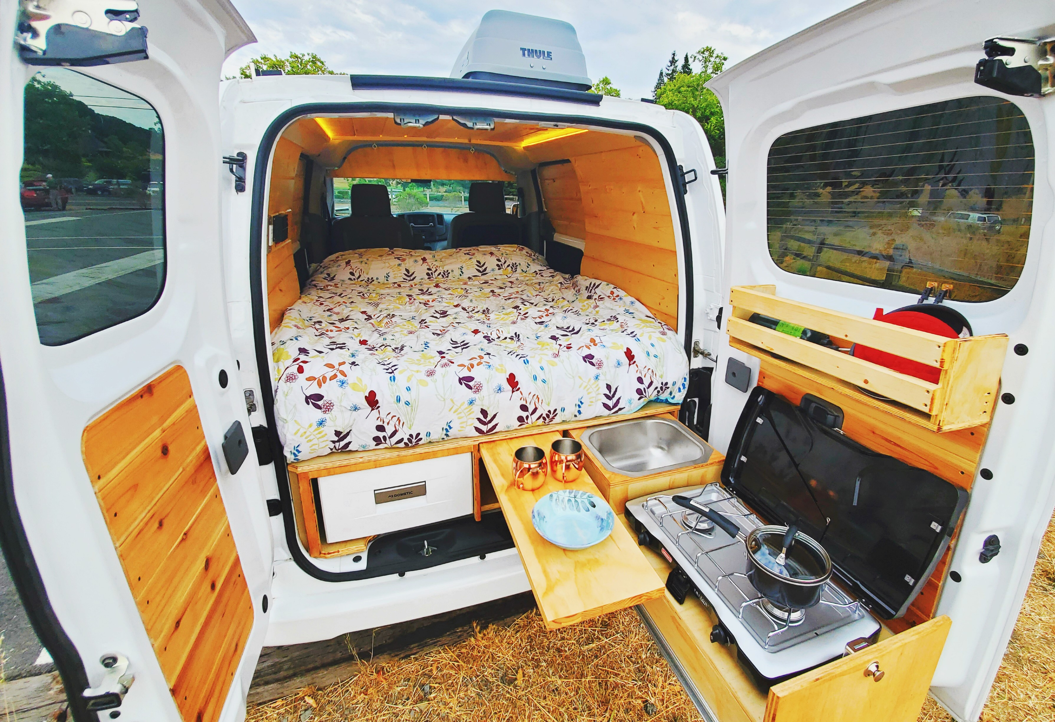 Kitchenware included with rental including silverware, plates, bowls, pot, pan and cups!. Nissan NV200 2019