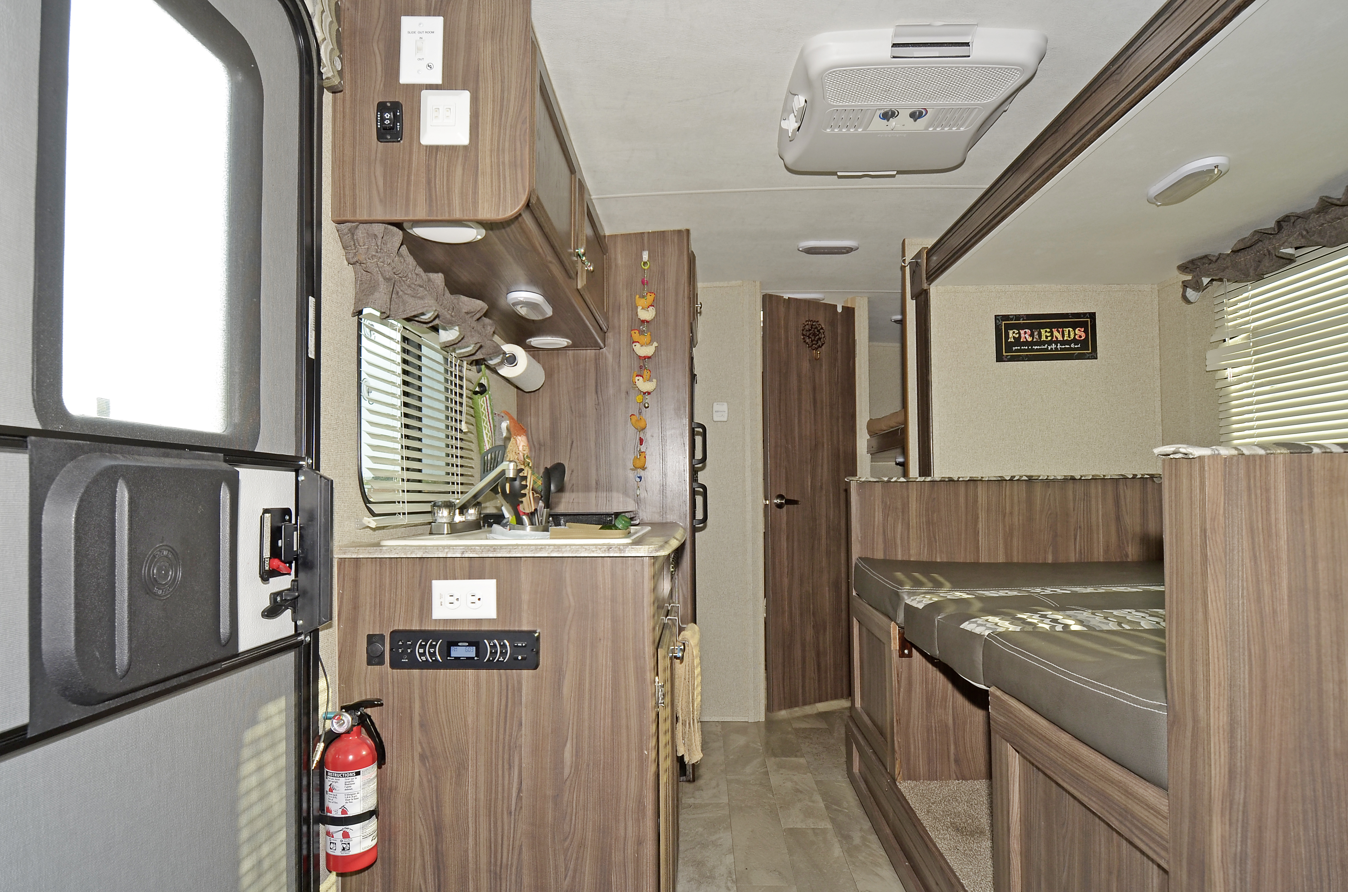 Inside View Radio with 2 inside speakers and 2 outside speakers. Coachmen Apex 2018