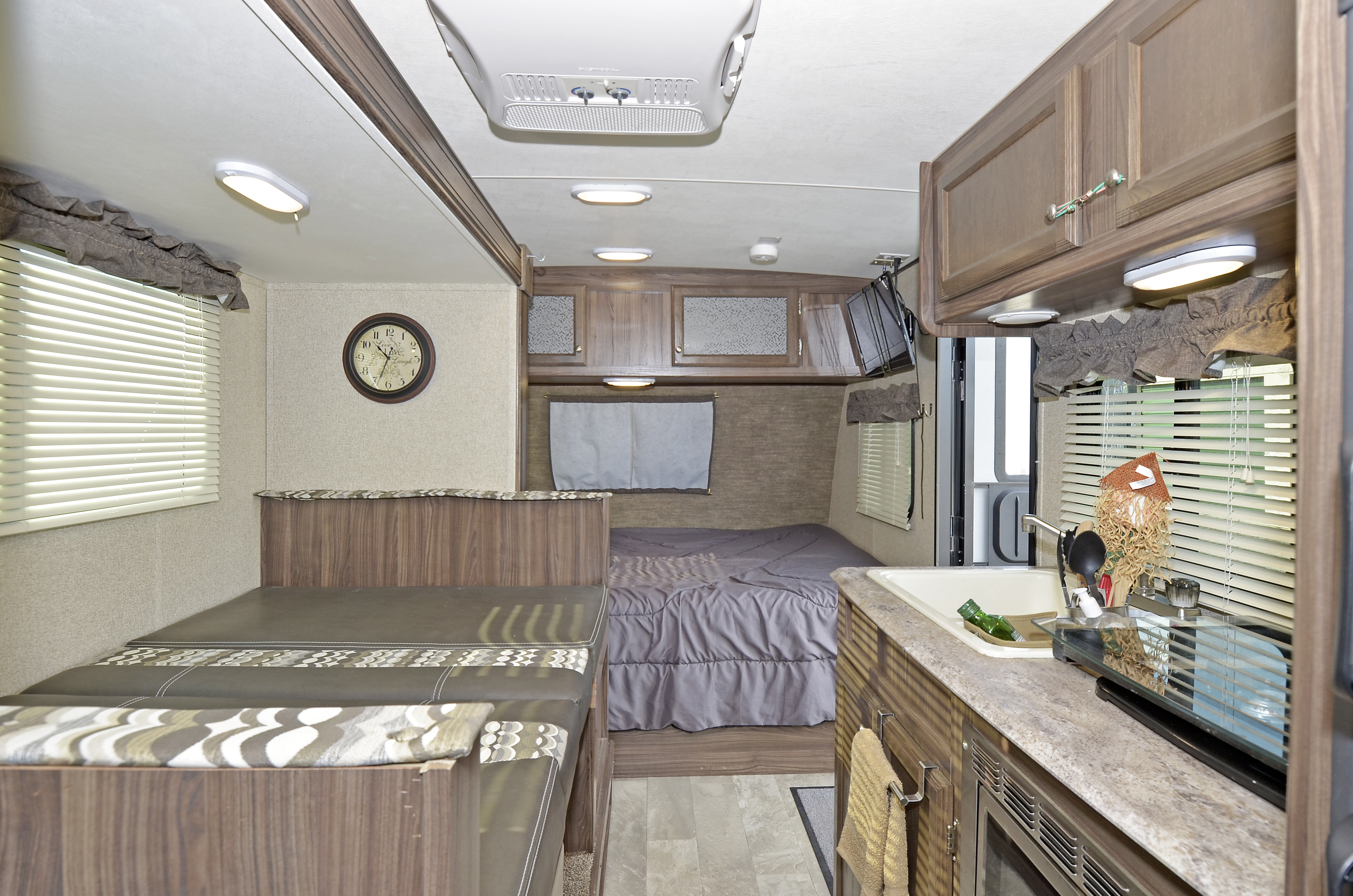 Table used as bed - fits 2 (or 1 adult comfortably) / storage under cushions. AC on ceiling. . Coachmen Apex 2018