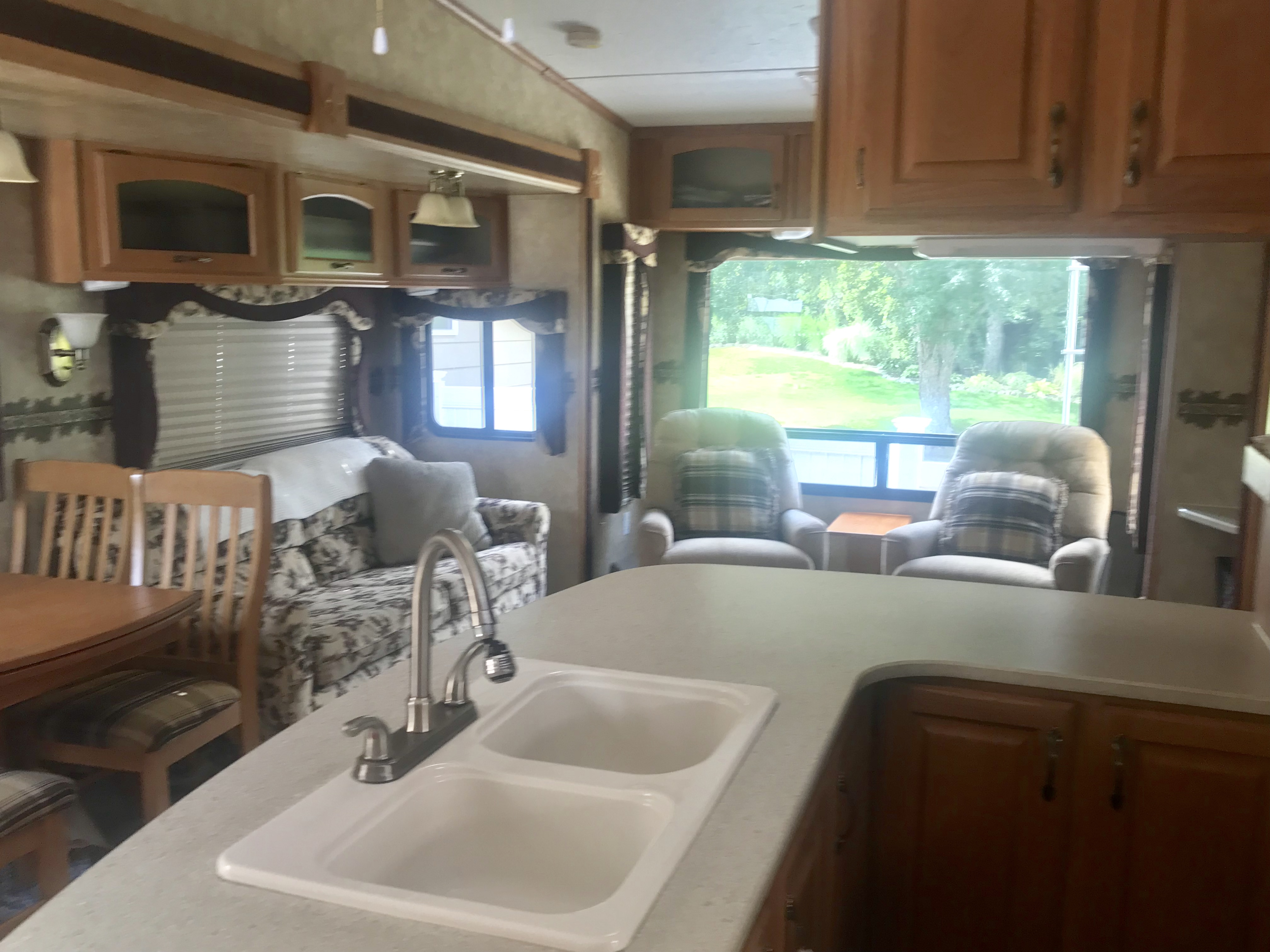 Table for four in the living area with expandable option. Living area and bedroom both have TV's. . Jayco Eagle 2008