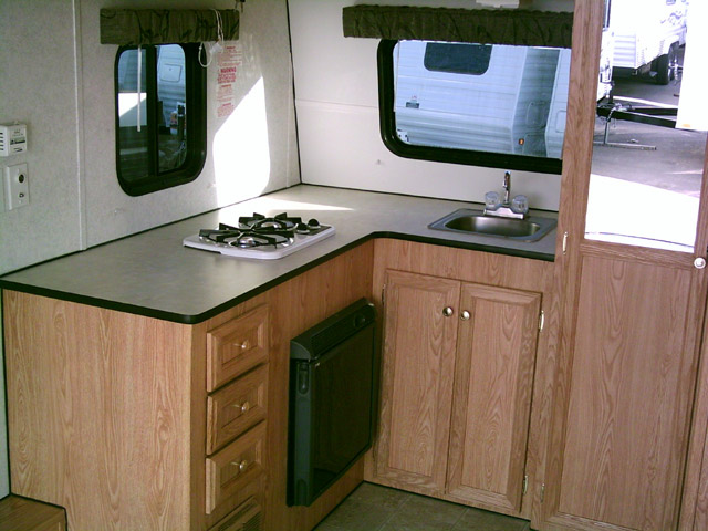 Propane stove and refrigerator that runs on shore power or of the batterys on board.. Carson Trailer Fun Runner 2007