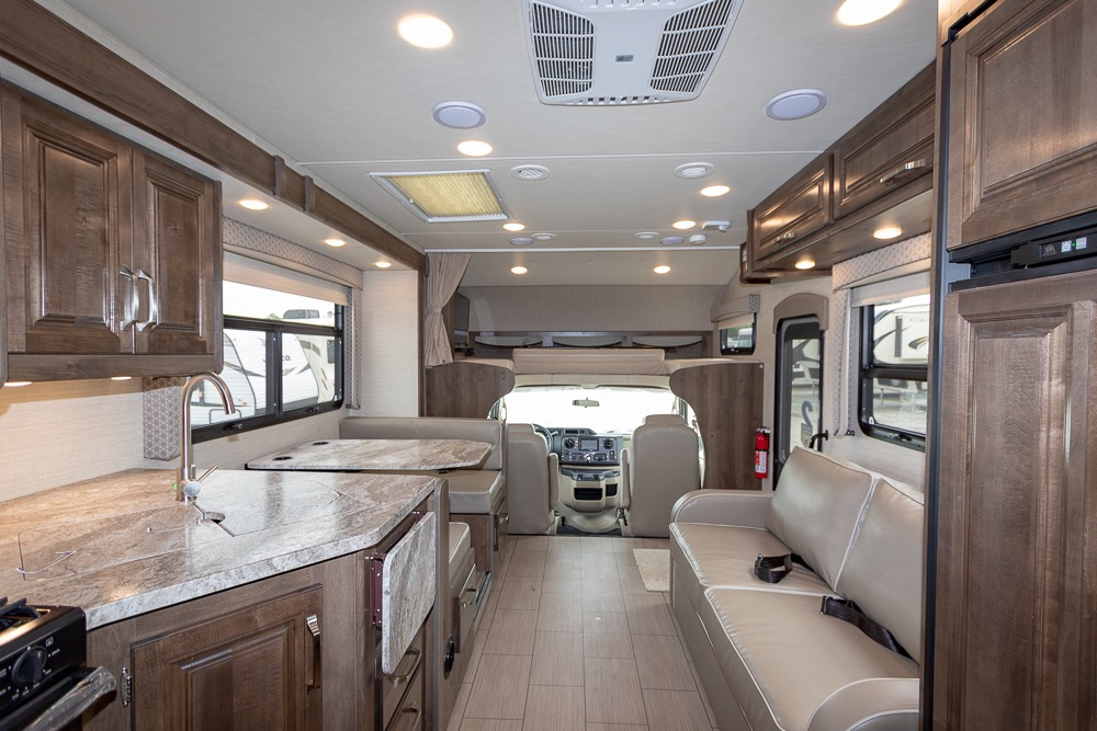 The interior living space is generous, gorgeous, and full of sunlight.. Jayco Greyhawk 2019