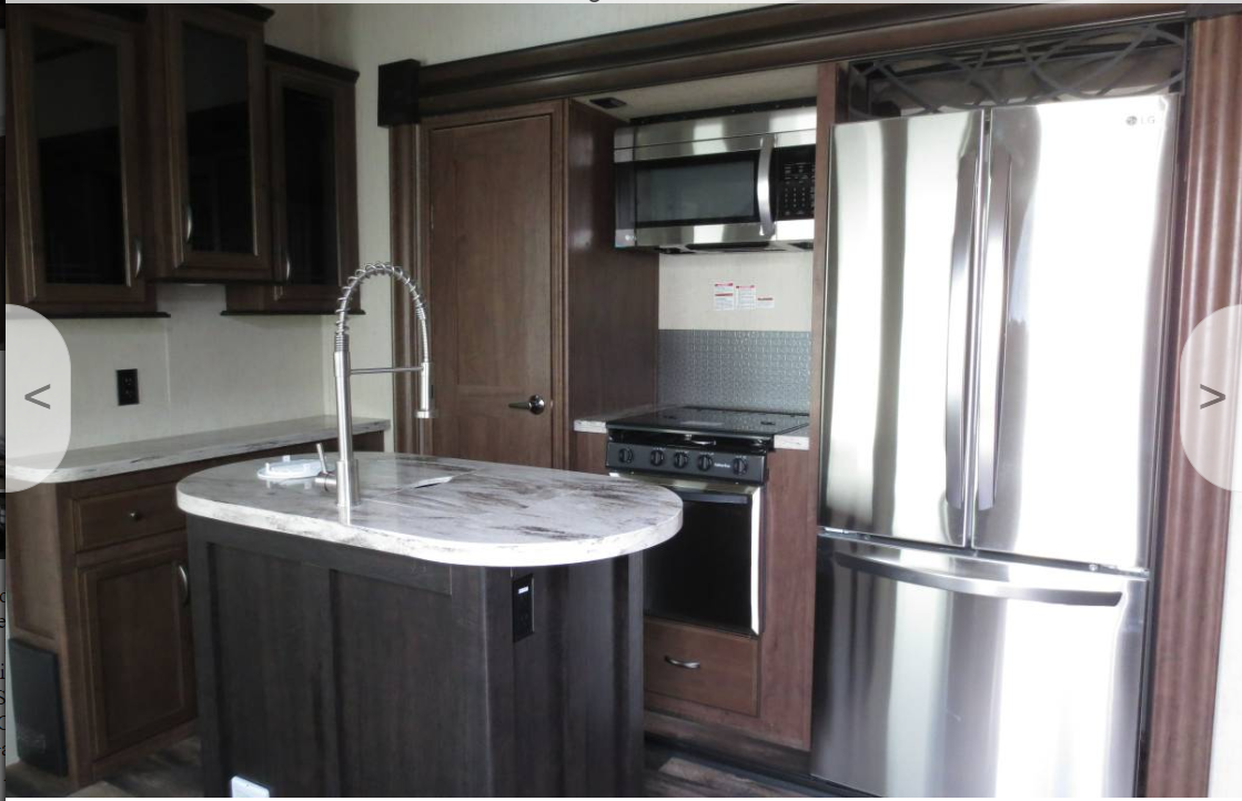 Spacious kitchen with a pantry, cabinets, microwave, stove top and oven.. Forest River Sandpiper 2017