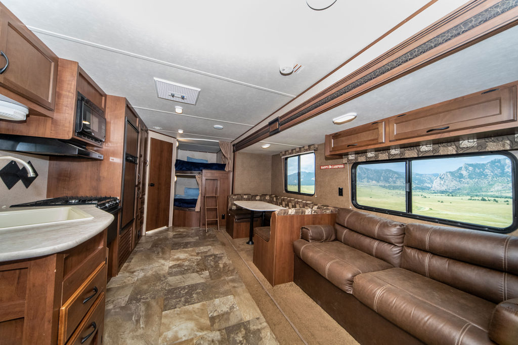 Large living area with dining table and two full-size bunks!. Jayco Jay Flight 2015