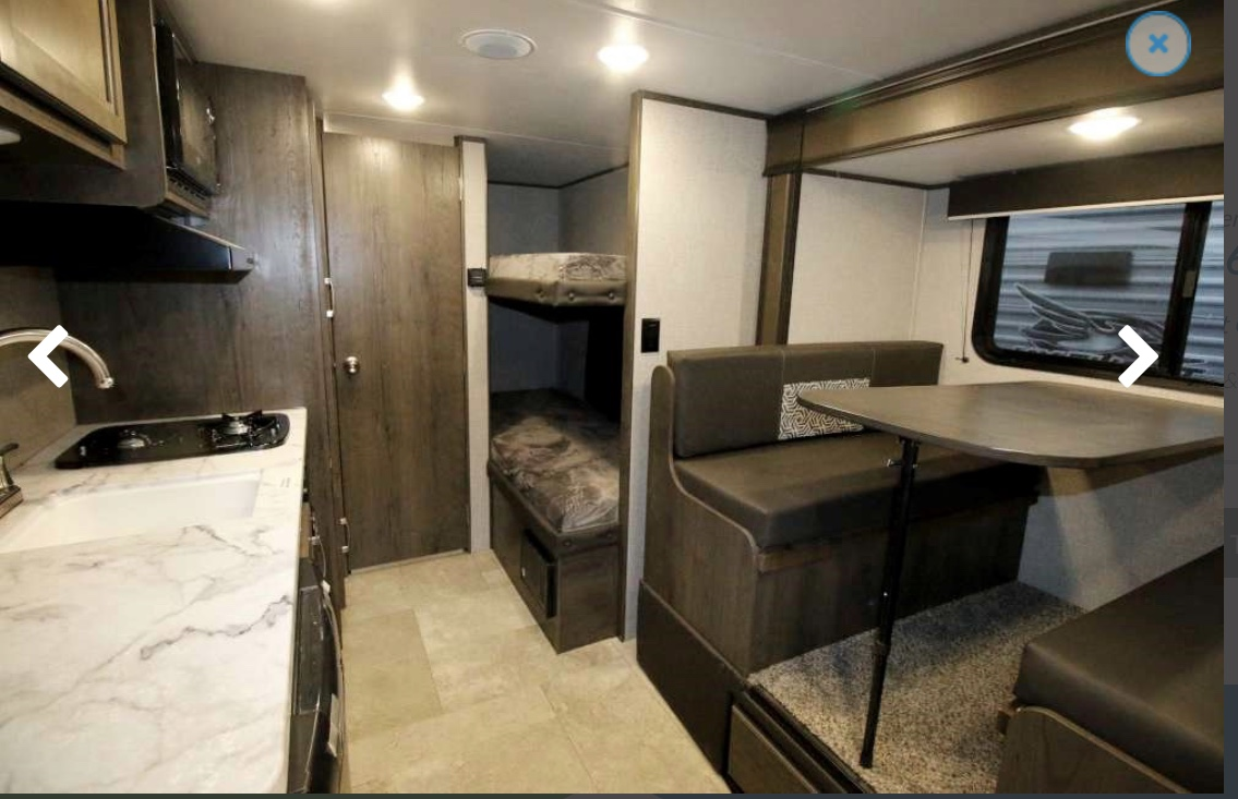 Interior view of bunks and dinette . Jayco Baja 2020