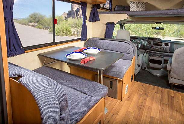 Dinning table fits 4 comfortably and turns into a bed when needed. Thor Motor Coach Four Winds Majestic 2013