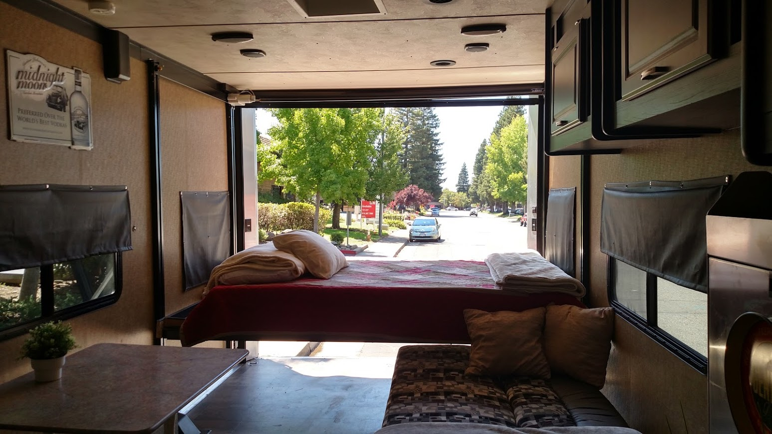 "Rear queen bed raises up to a height of 72"" Rear screen door (not shown) Sleeps 4-6 comfortably. Forest River Work And Play 2014"