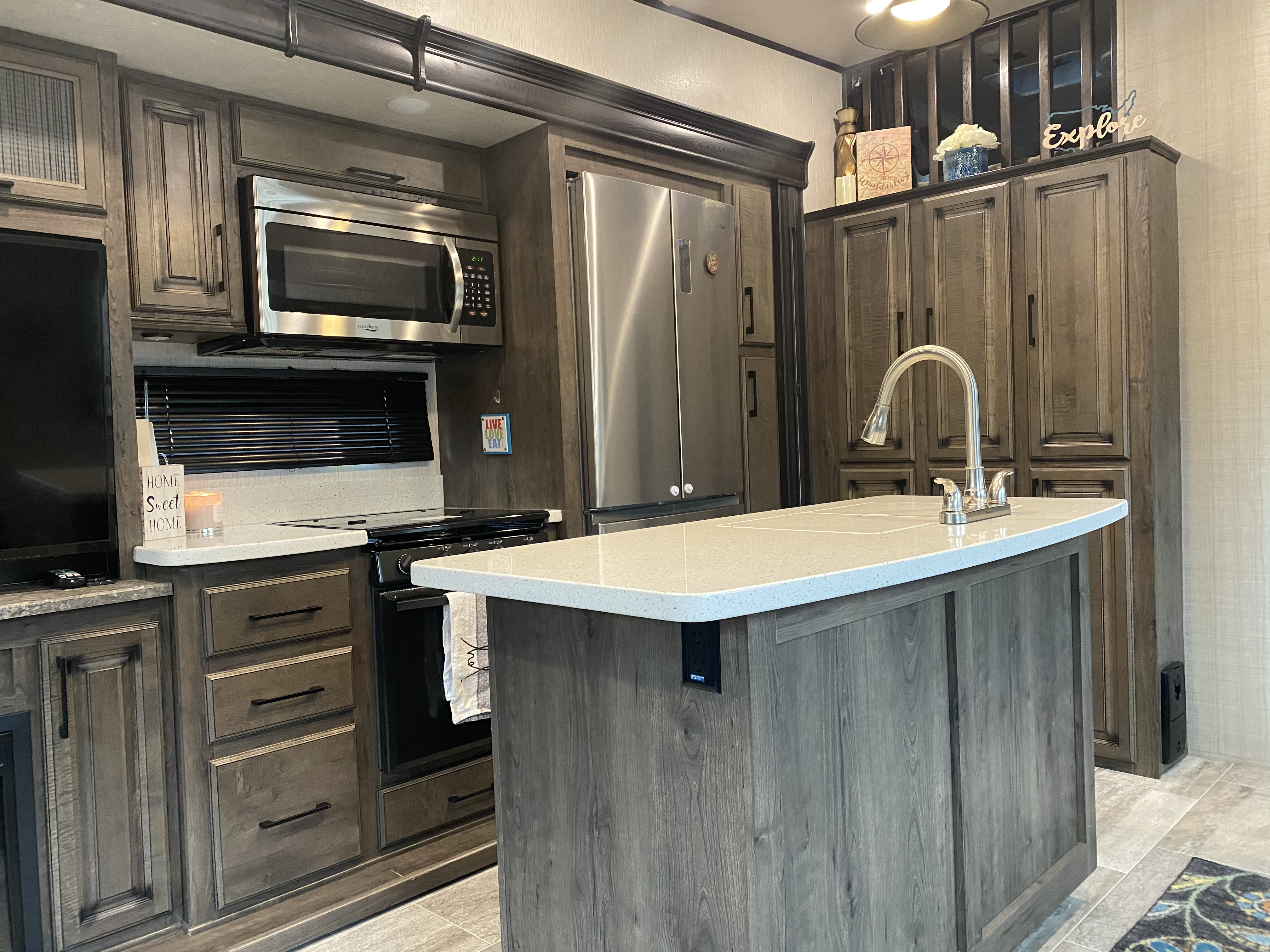 Kitchen island and solid surface counter tops provide plenty of space for food preparation. Did you see the residential fridge?. Heartland Gateway 2019