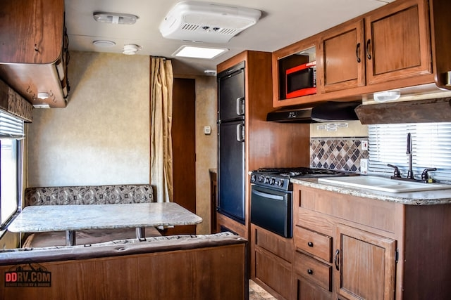 Full view of kitchen and table. Wildwood 32qbss forest river 2014