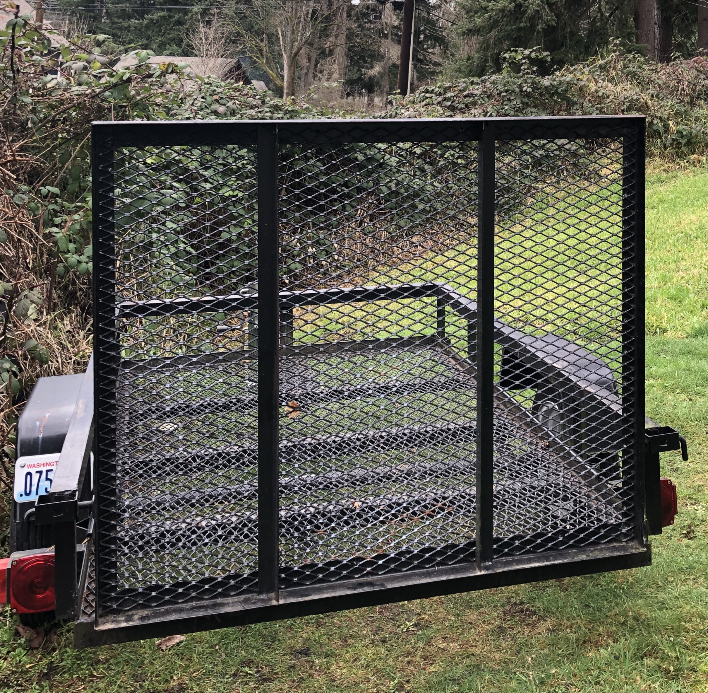 Back Gate - ability to remove and use as ramp. . Lippert Components, Inc. 4x6 Trailer 2015