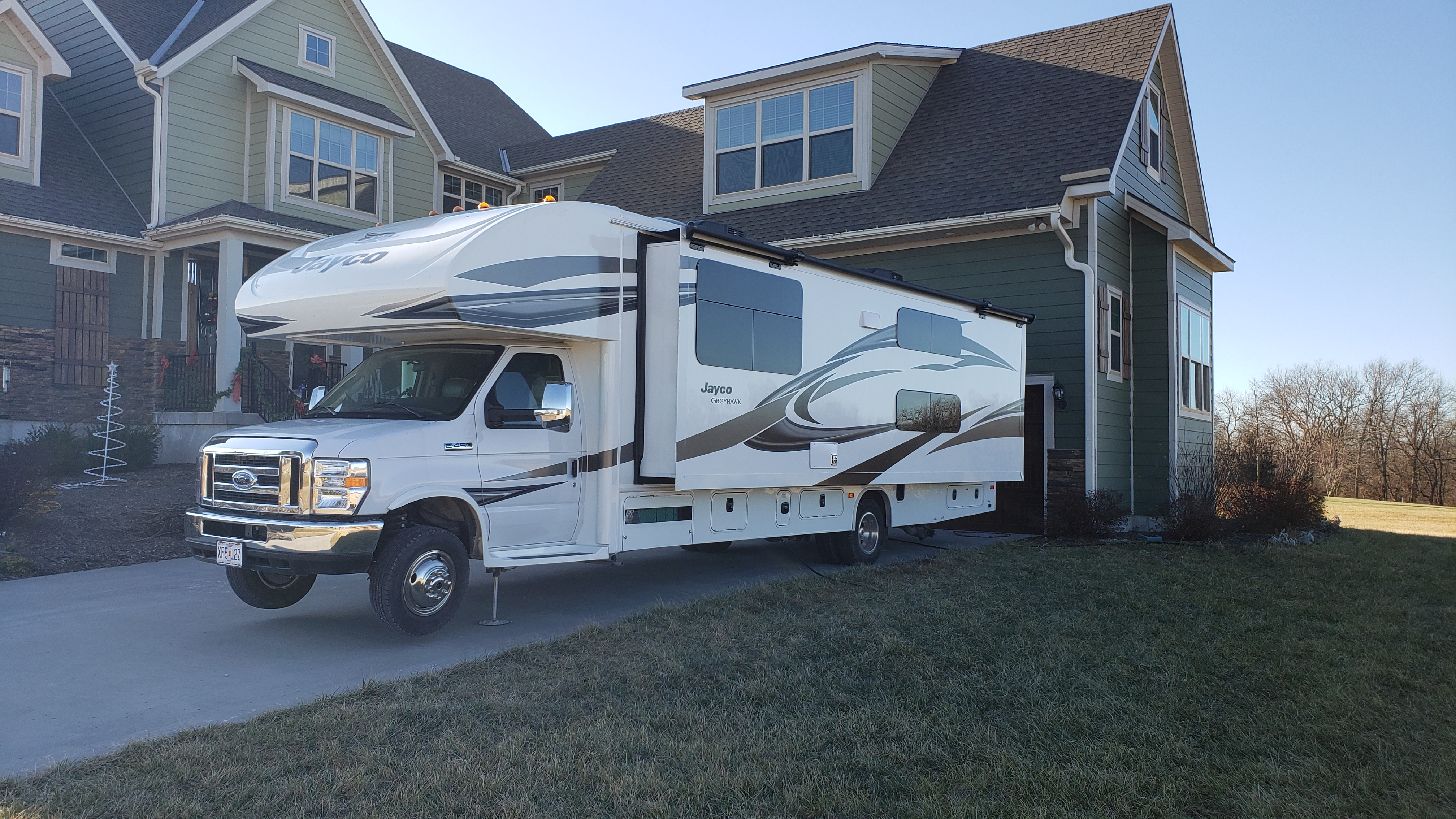 Outside with slide out and automatic levelers deployed. Jayco Greyhawk 2019