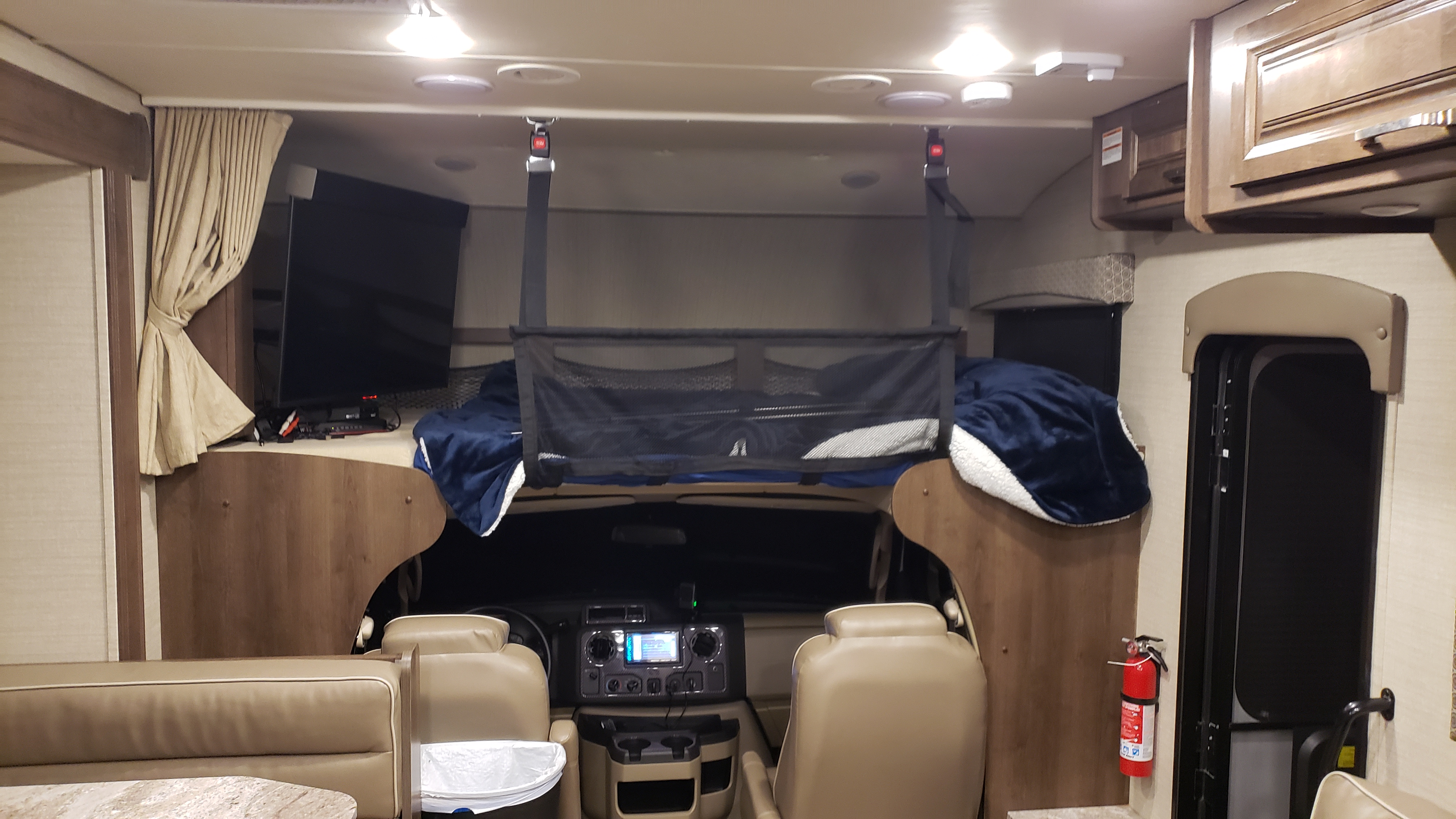Cab over bunk with TV. Child Safety net is installed. Jayco Greyhawk 2019