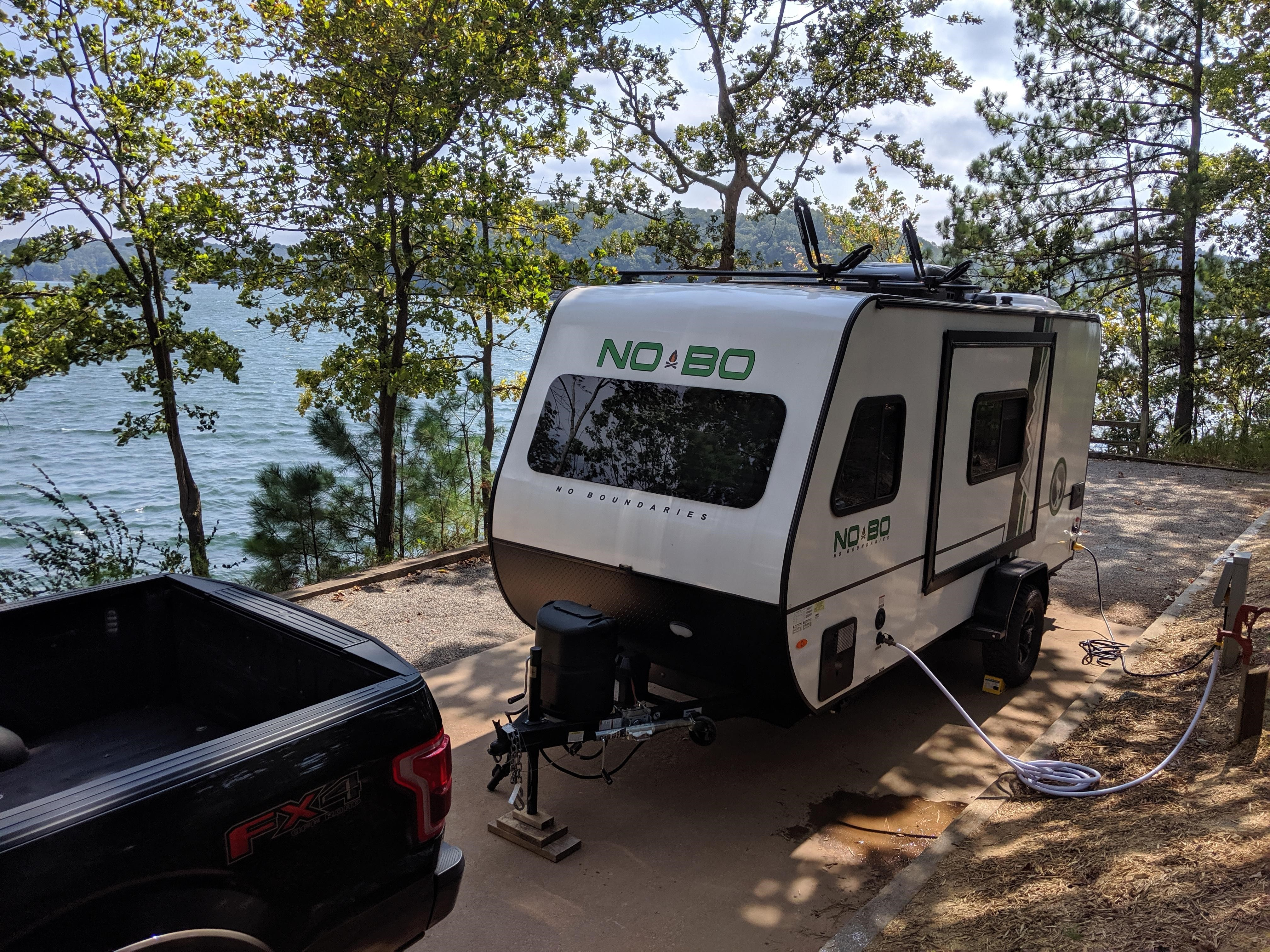 The NOBO 16.8 has the same width as most standard vehicles. This photo gives you an idea of the body width before the slide is extended. Makes towing EASY.. Forest River No Boundaries 2019