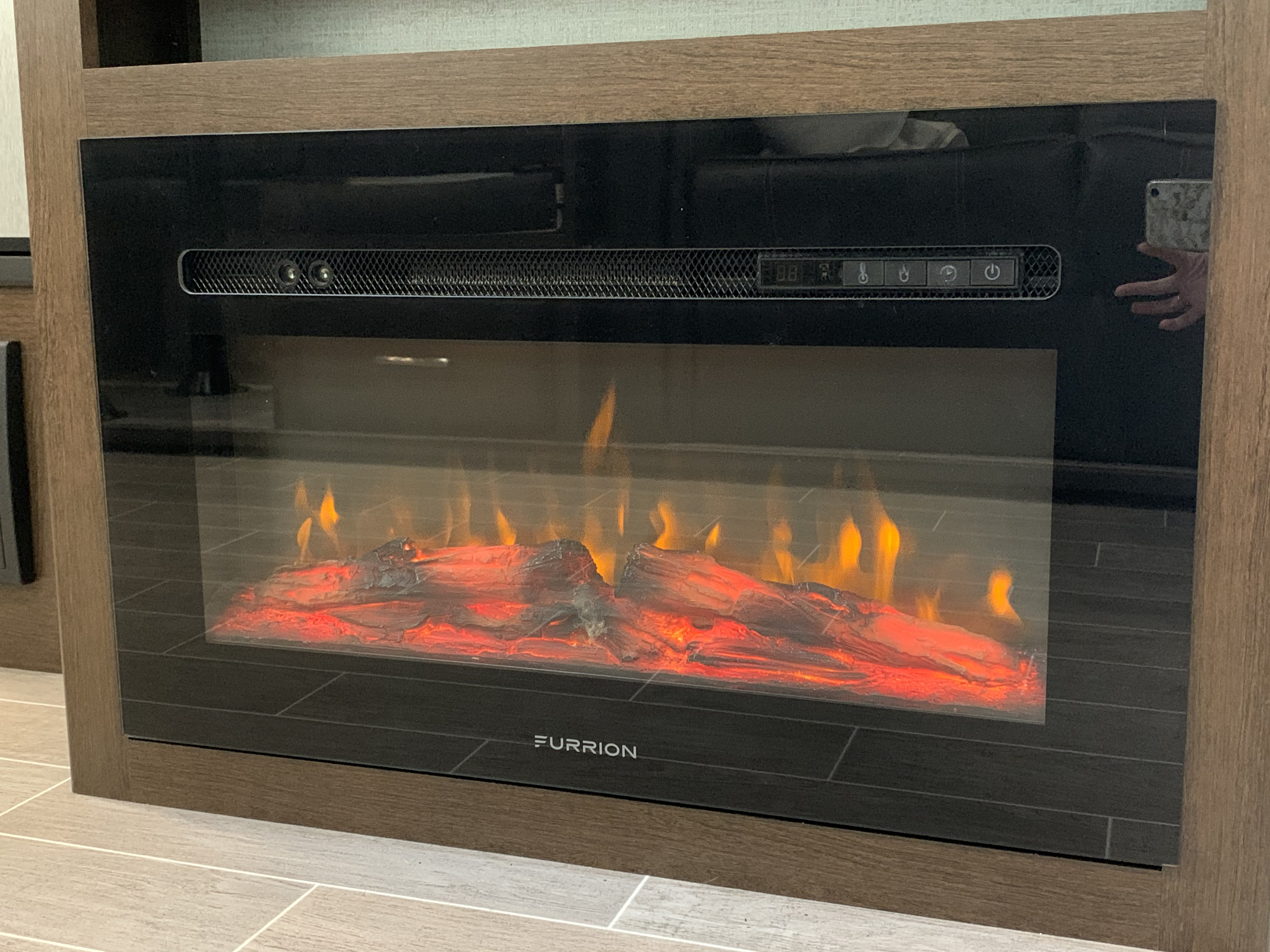 Electric Heater with temperature controls and fire place display to keep you nice and cozy on those cold nights. . Dutchmen Atlas 3202BH 2020