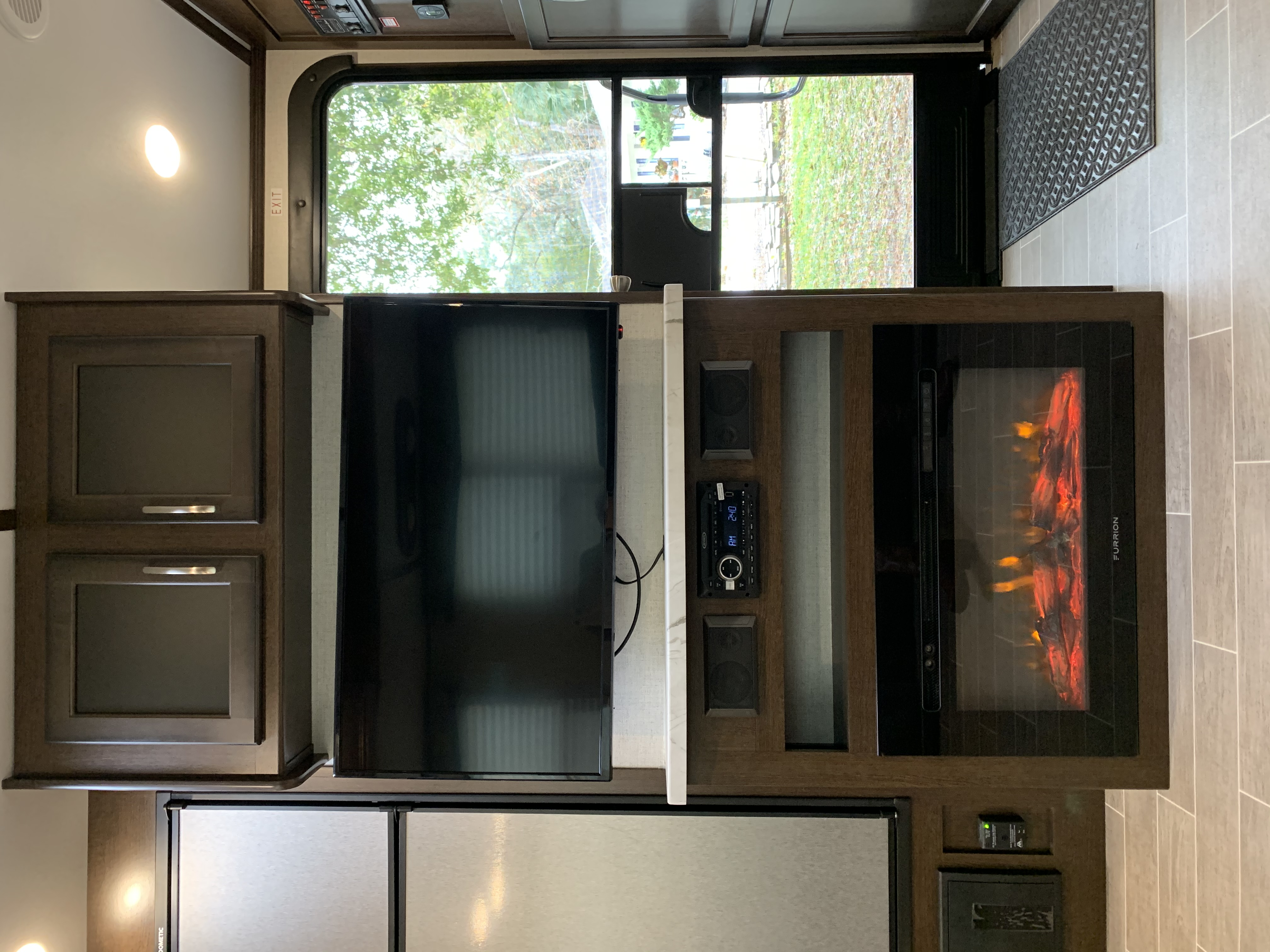 TV with electric heater fireplace and stereo that can be listened to inside and or outside. . Dutchmen Atlas 3202BH 2020