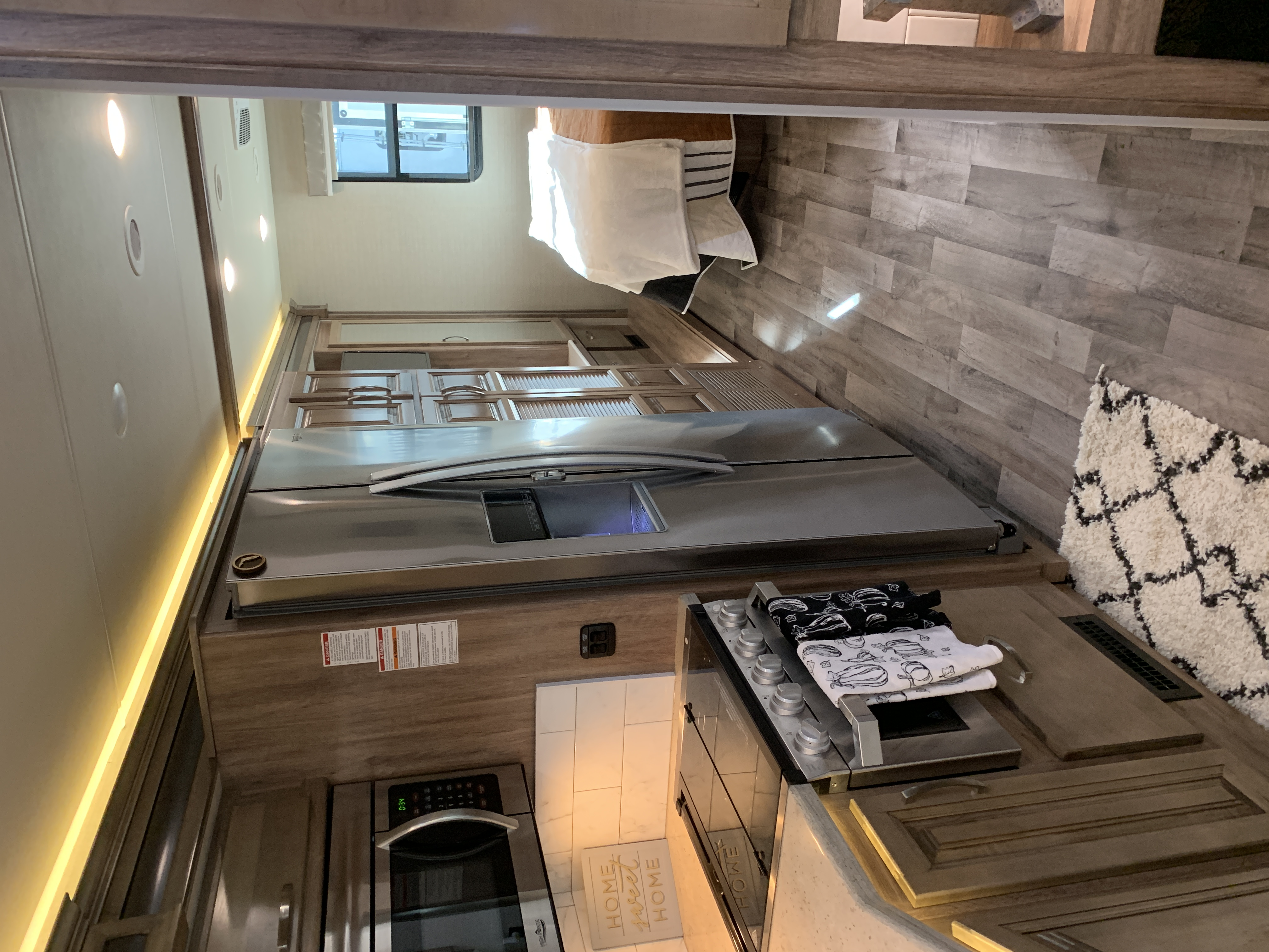 View of Kitchen into the bedroom. There is a sliding door to close off the bedroom from the rest of the RV . Jayco Precept 2020