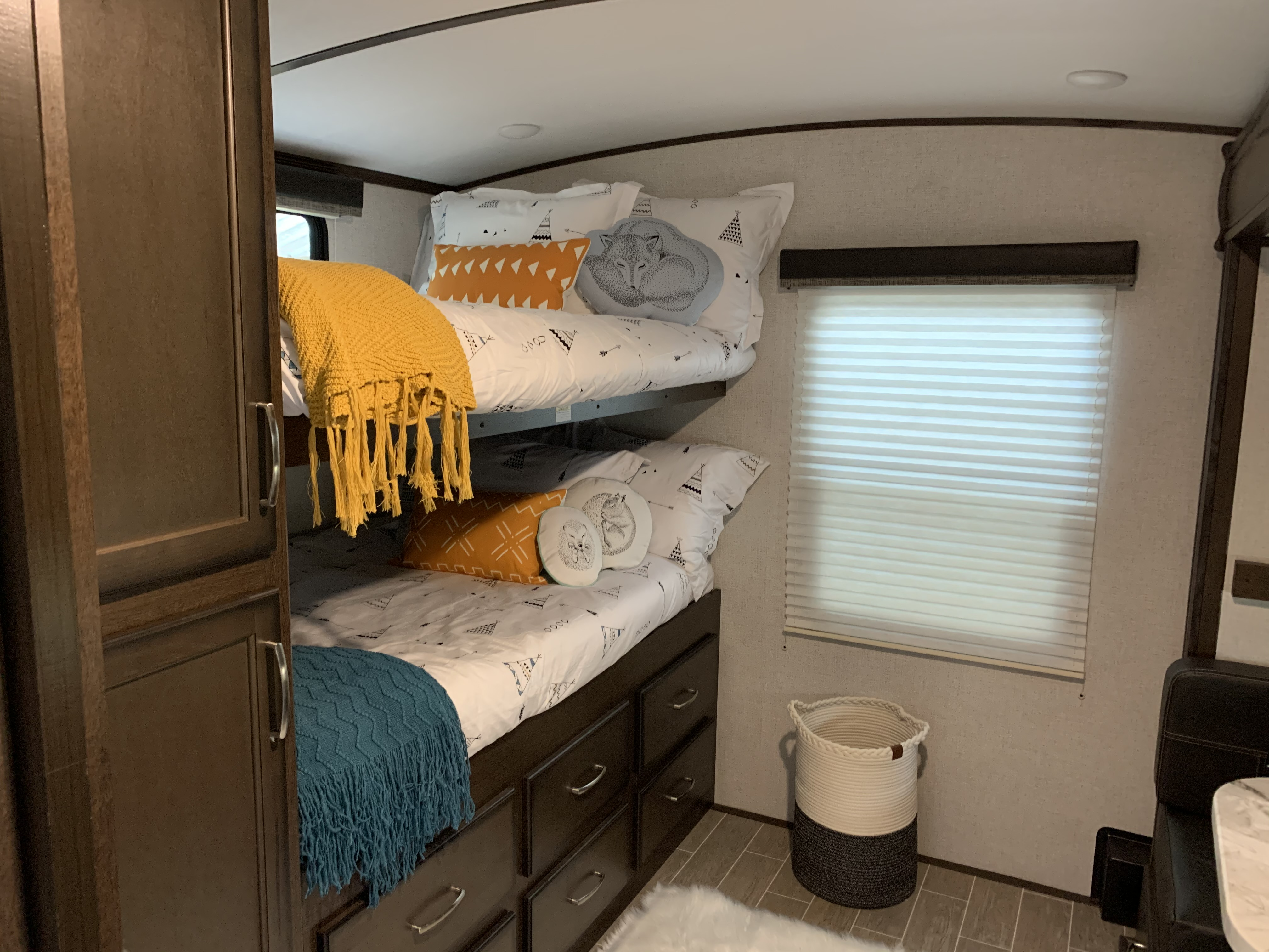 *Bunk Room* This view shows 2 3/4 full bunk beds. Other side of bedroom has a single bunk, and a small dinette that turns into a single bed. This room comes with a ton of storage!. Dutchmen Atlas 3202BH 2020