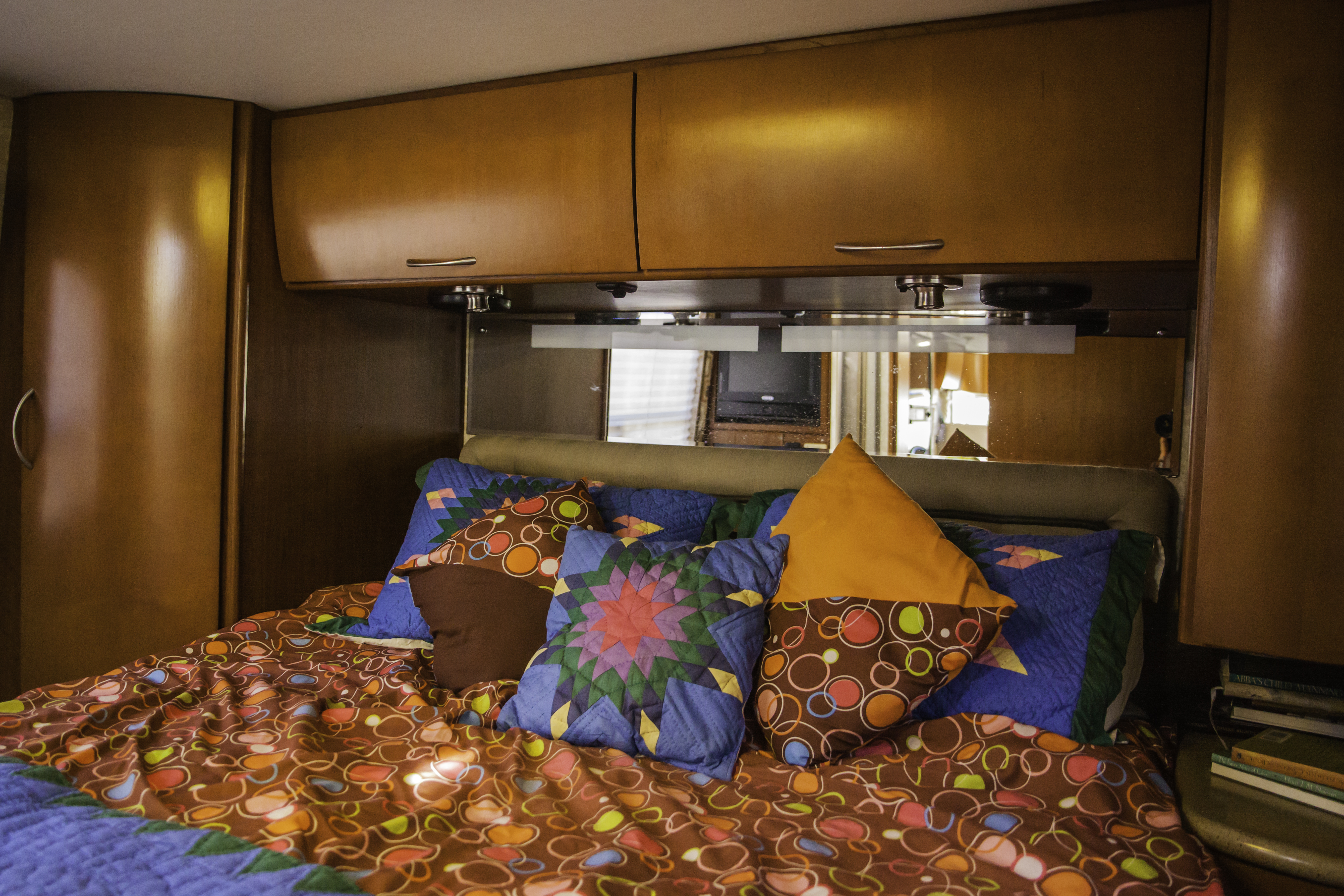 comfy gel/foam topper with reading lights and tv to boot!!. Thor Motor Coach Serrano 2010