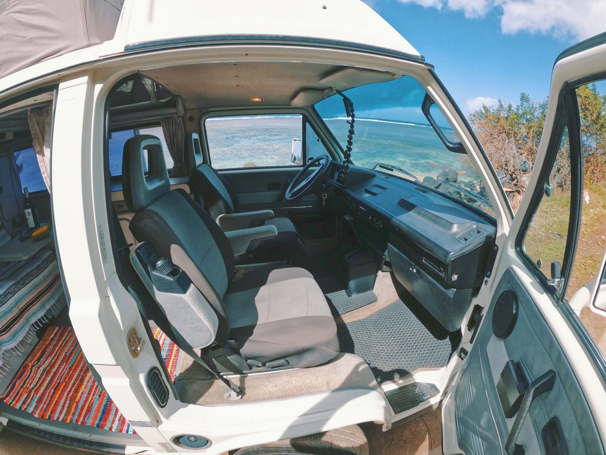 Cruise the island in style and comfort. The front seats swivel to face each other, and face the back so you can lounge in comfort.. Volkswagen Vanagon 1990