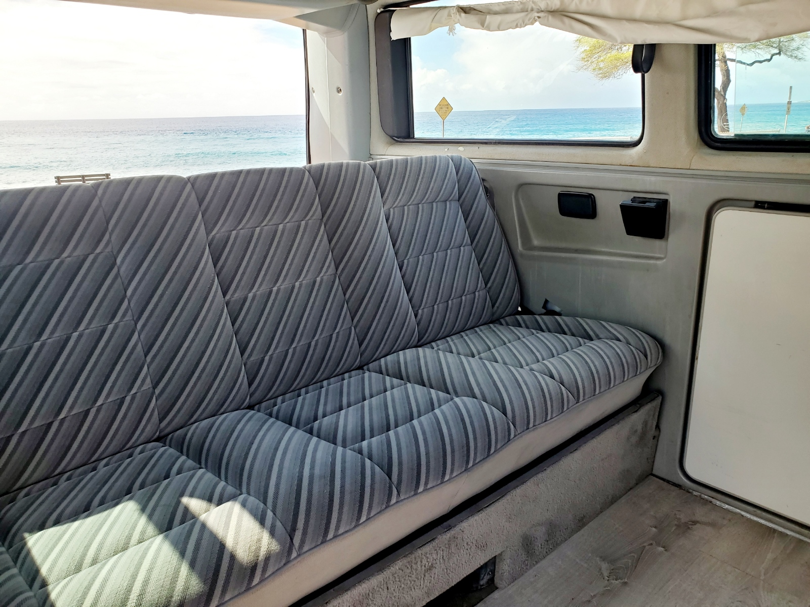 Back seat folds down into a bed, or keep it up for 3 seats with seatbelts.. Volkswagen Vanagon 1989