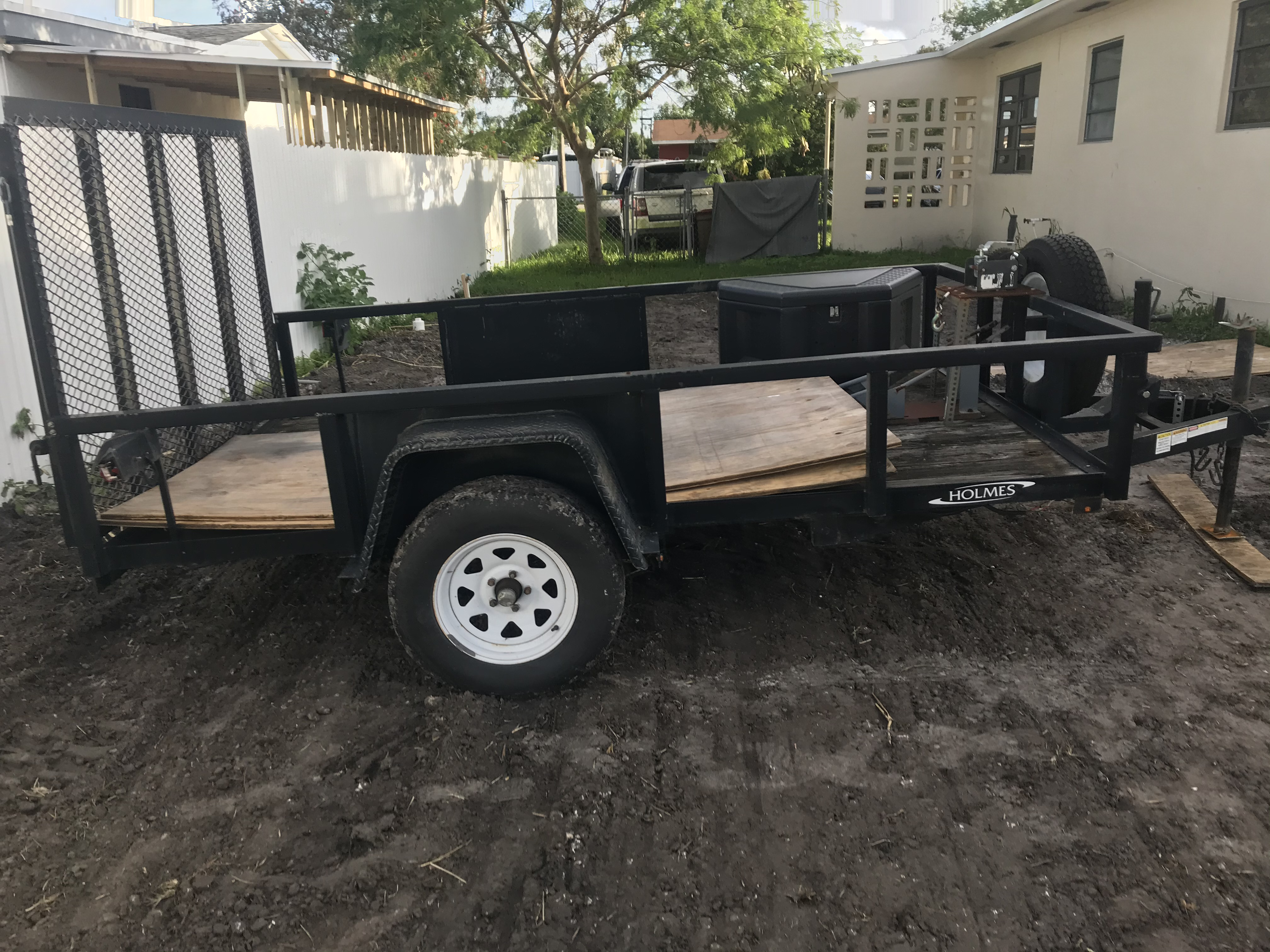 Utility Trailer With tilt and ramp assist 2017