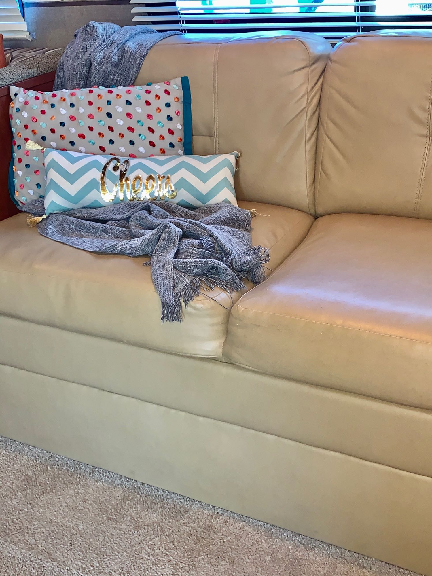 You enter into the interior and the slide-out makes it really comfy. This couch pulls out to a single bed for a child. We store extras under. Nice area to sit, chat, watch TV or read a book while you relax.. Palomino Canyon Cat 2015