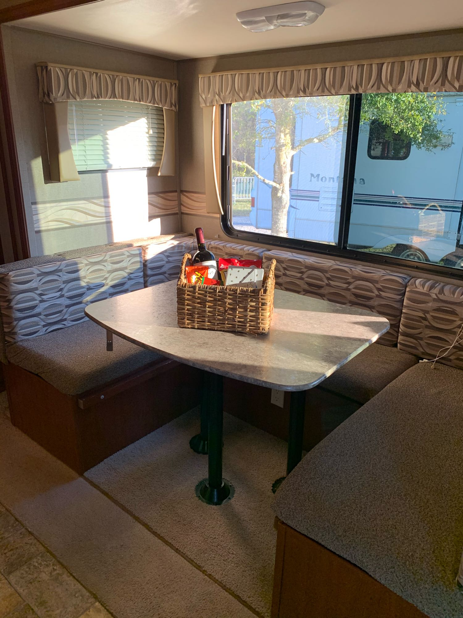 For each person, group or family who rents from us we try to customize a Welcome basket and leave some special goodies, Wine for Mom and snacks for everyone else sometimes a Smore's Kit my favorite.  This dinette seats 7 comfortably and makes into a full size bed for 2 adults.. Palomino Canyon Cat 2015