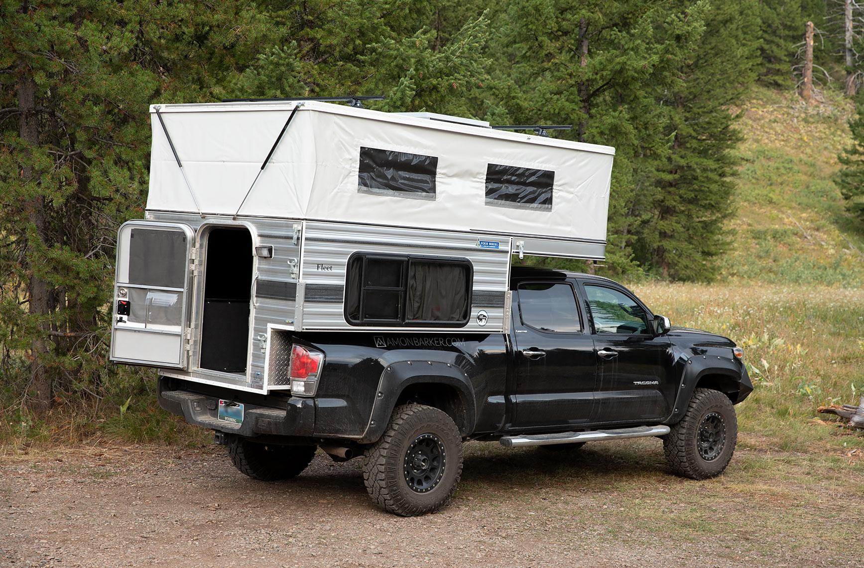 The back door can be latched open or closed. Four Wheel Campers Fleet 2016