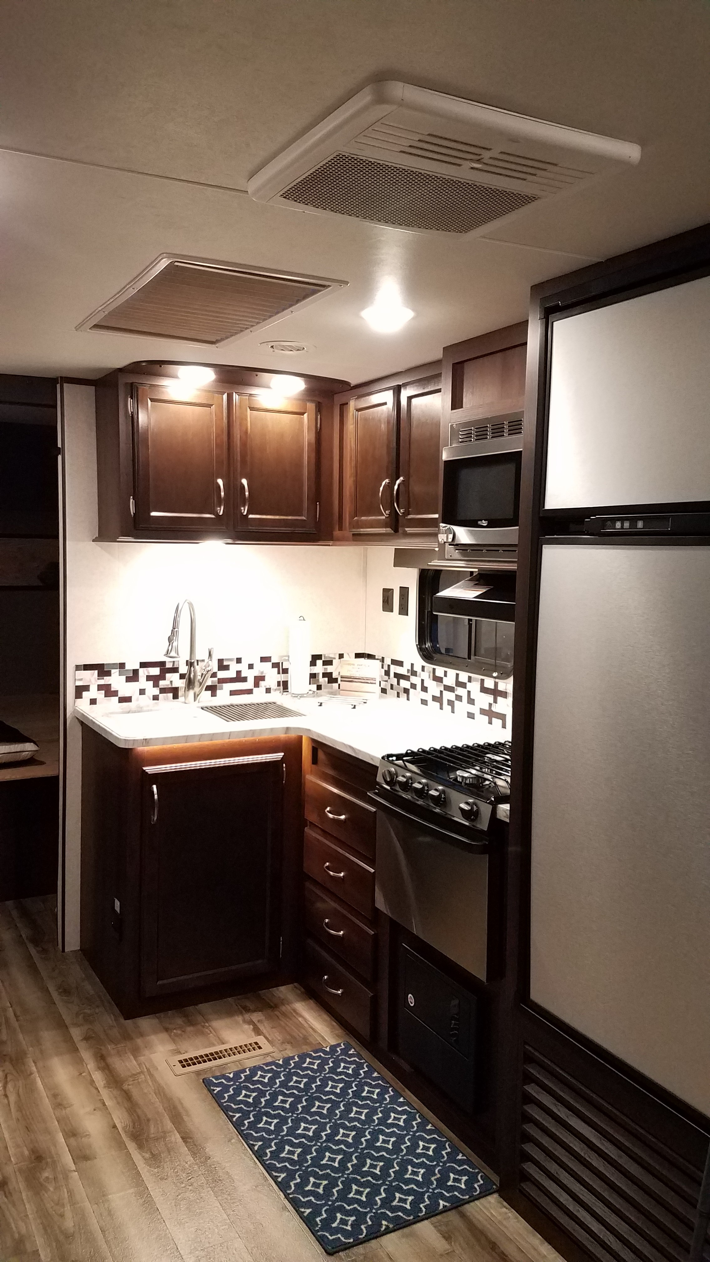 Kitchen with an updated counter top and stainless steel sink.. Jayco Jay Flight 2018