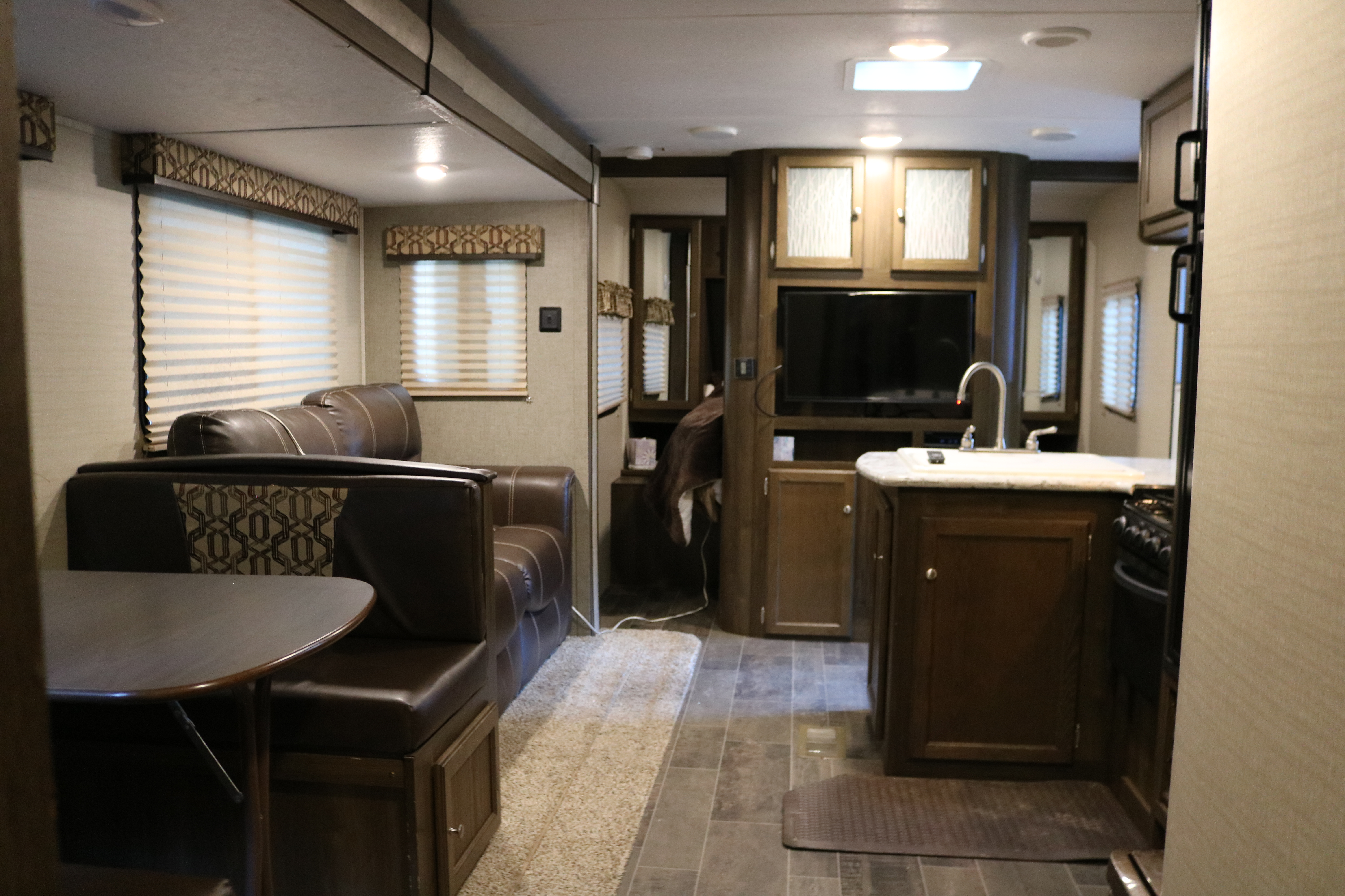 Main Living area with fold out couch and fold down table.. Keystone Bullet 2018