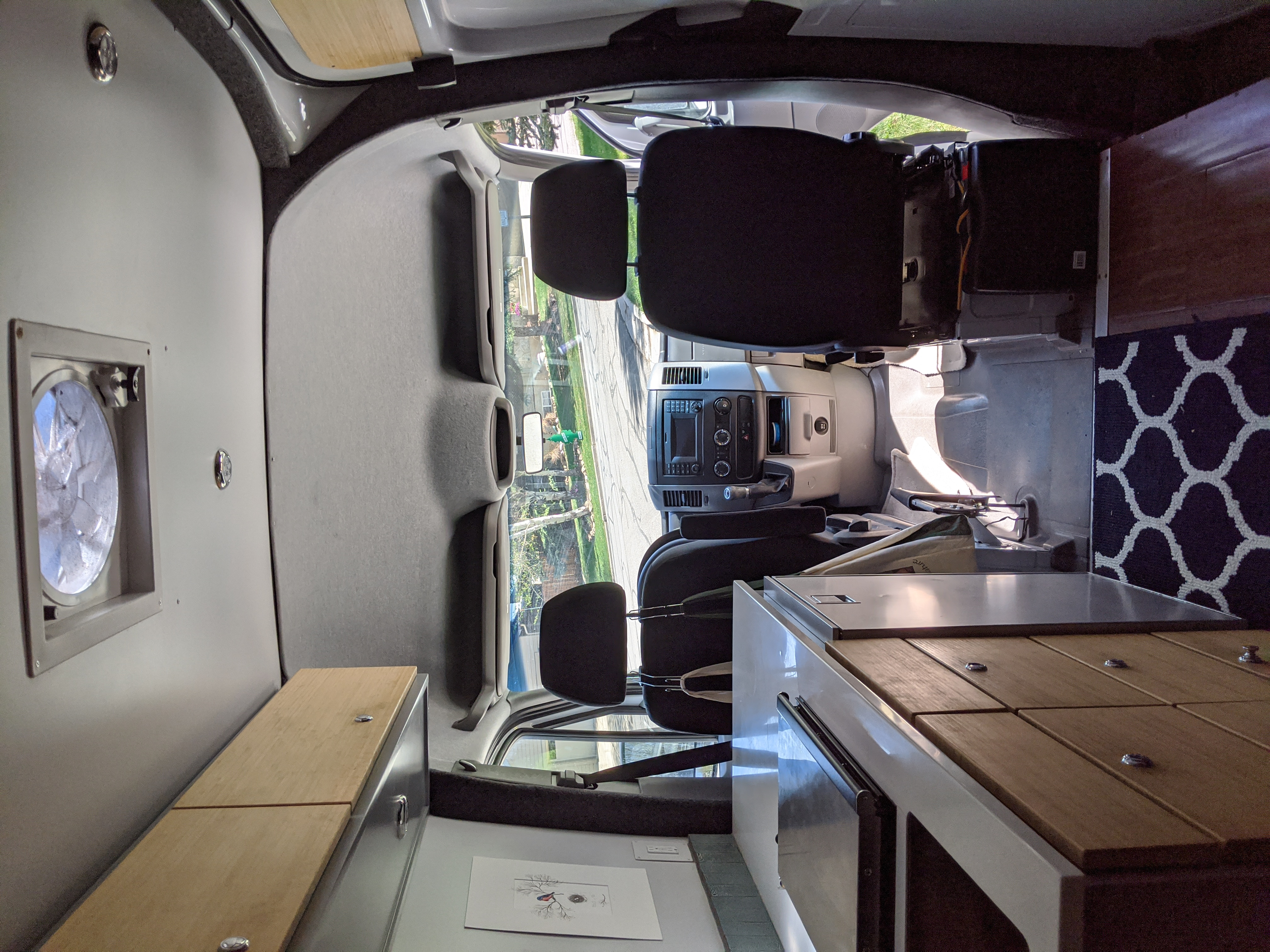 Looking forward and on the right is an extra butane one burner stove and there is also a fire extinguisher in the van.. Mercedes Sprinter 2015