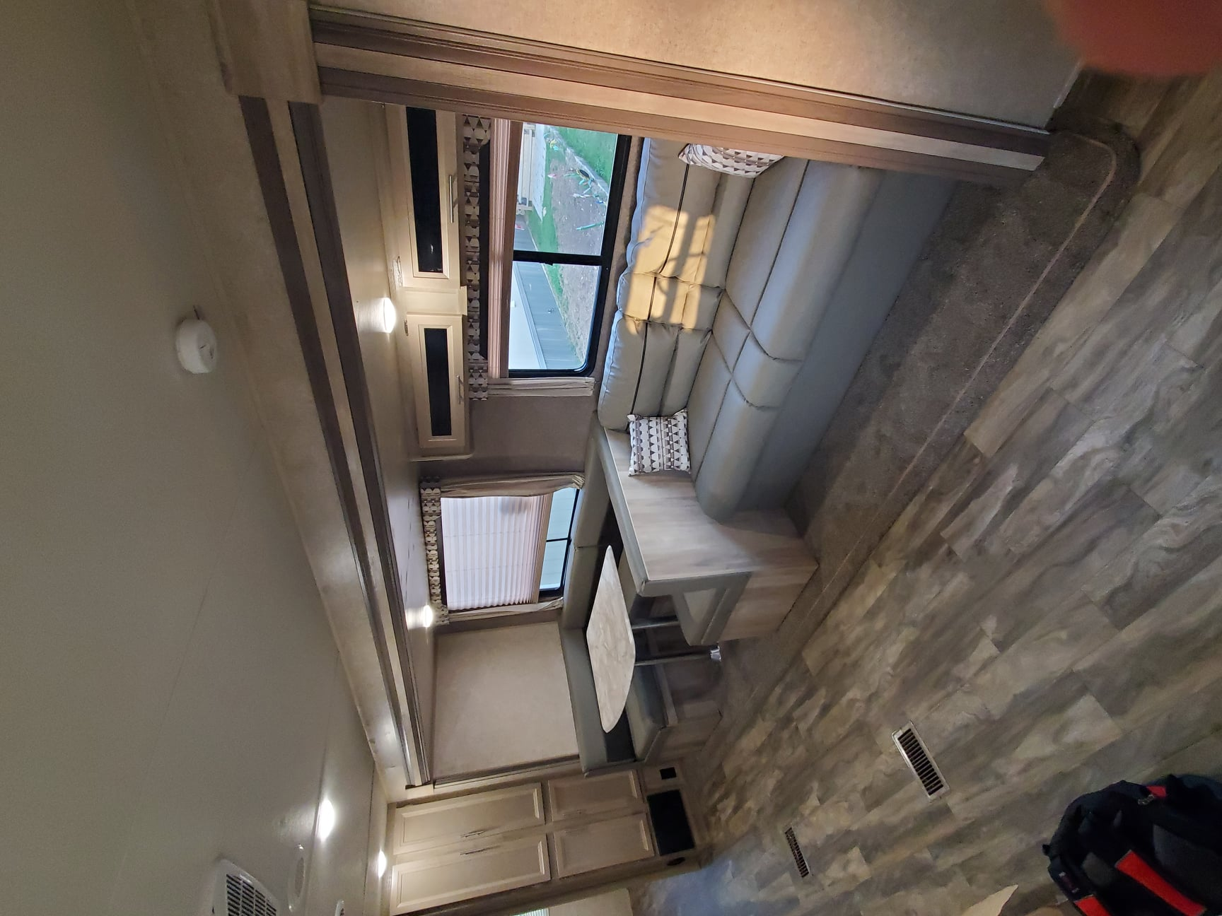 Couch, pulls into sleeper with overhead storage. Forest River Catalina 2020