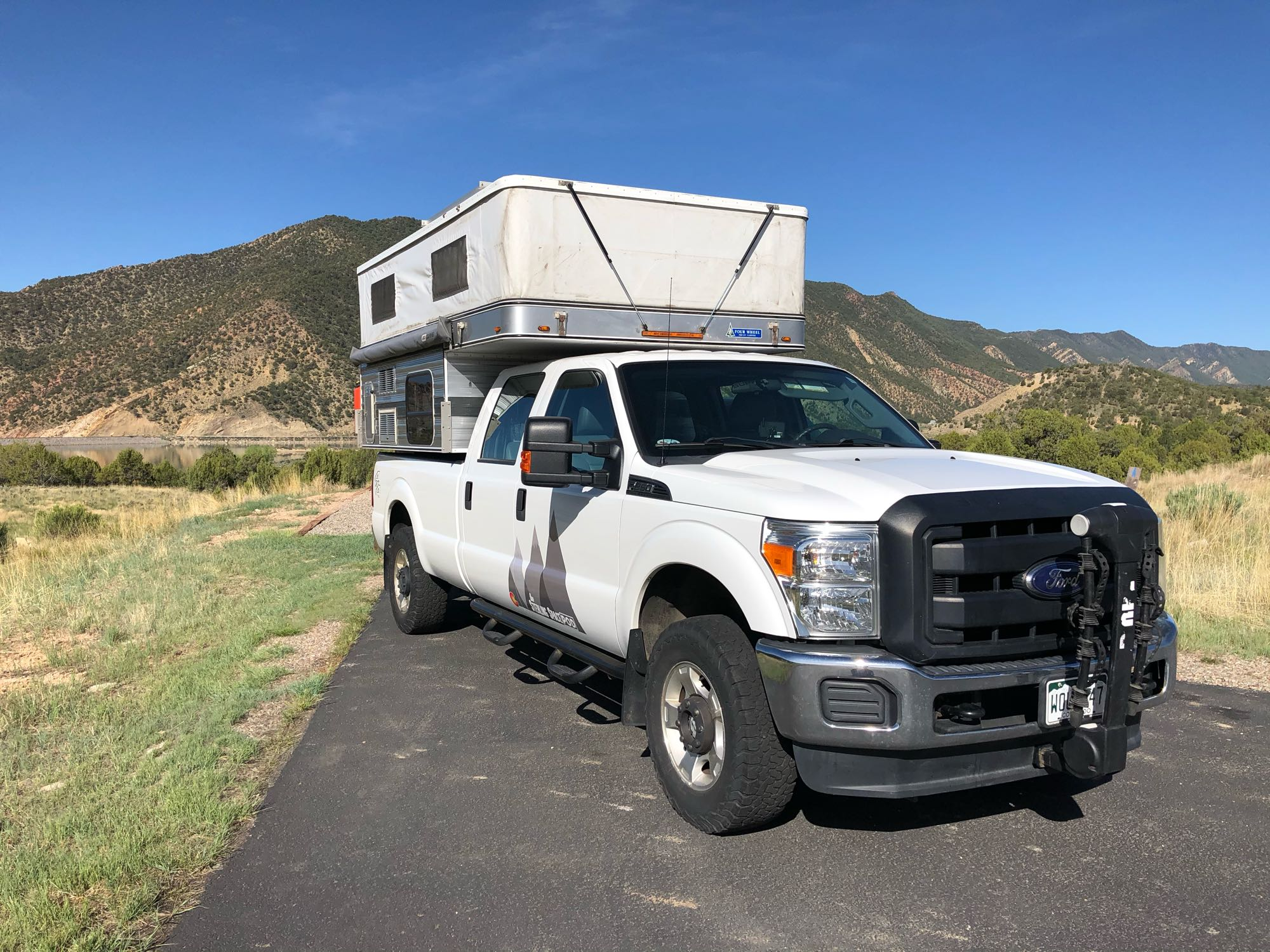 Popped up & view of awning (rolled up).. Four Wheel Campers Grandby 2015