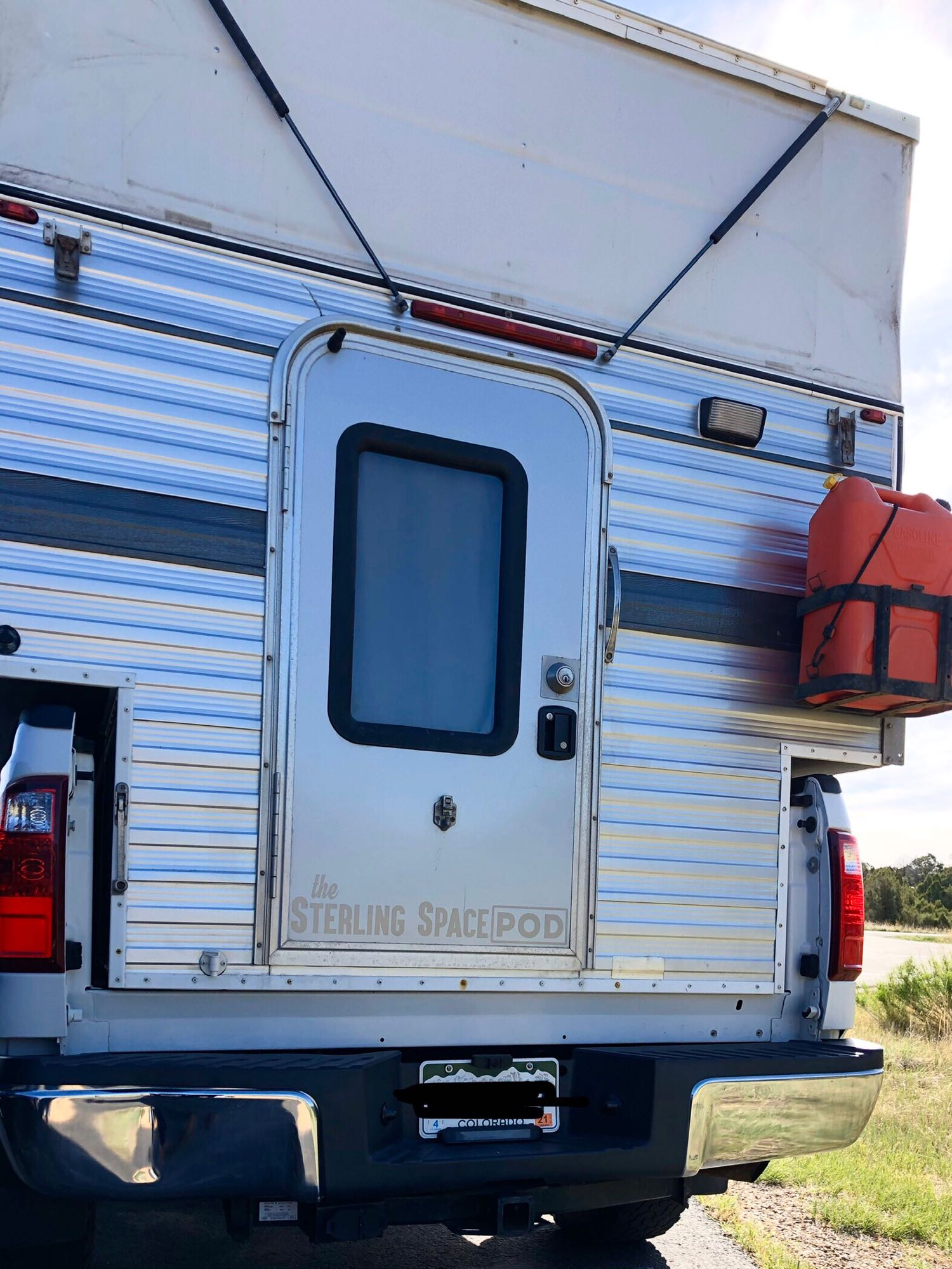 Back door & extra gas can.. Four Wheel Campers Grandby 2015