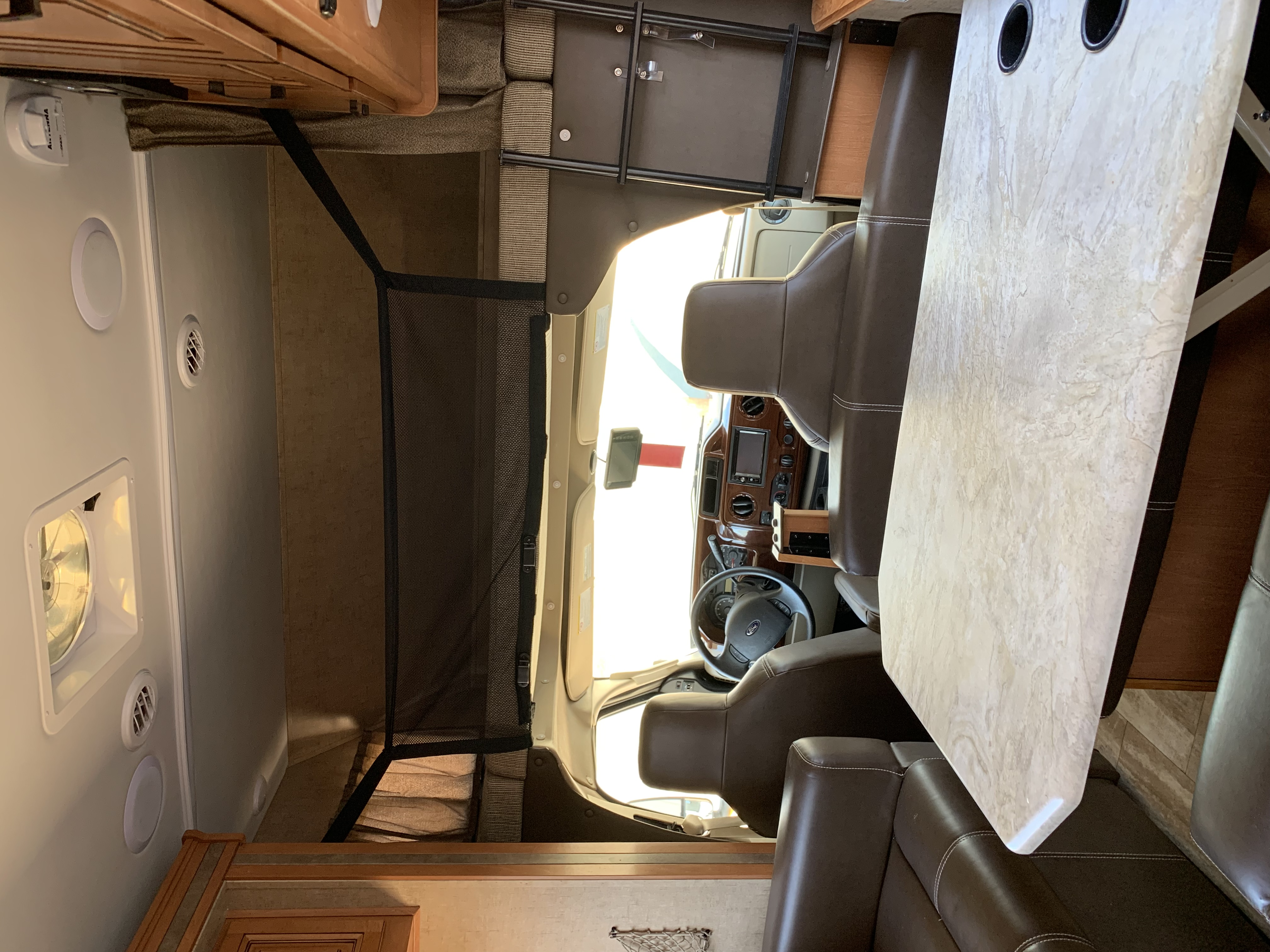 Comfortable Driving Area with full screen back up system. Driver seat rotated to turn into the living area for additional seating. Forest River Forester 2017