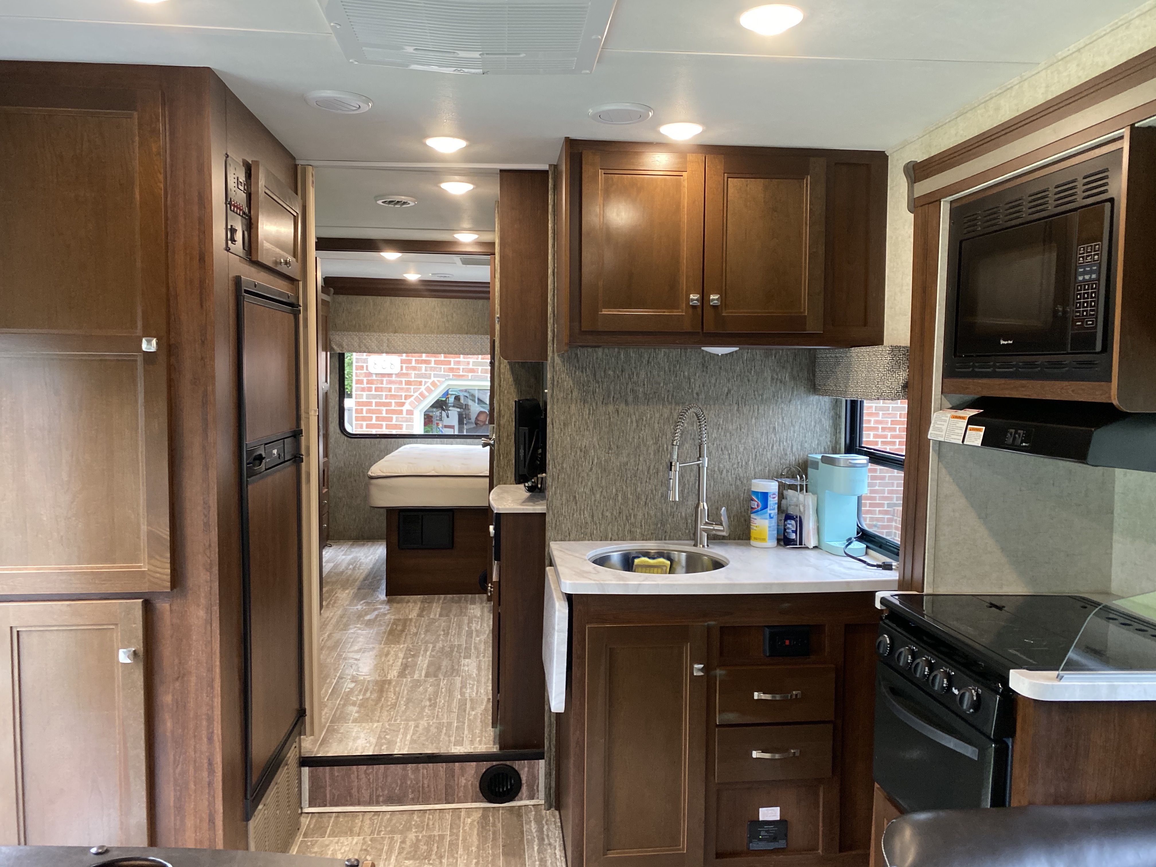 Kitchen. Counter pulls out for more space. Silverware, dishes, pots and pans provided.. Forest River Sunseeker 2018
