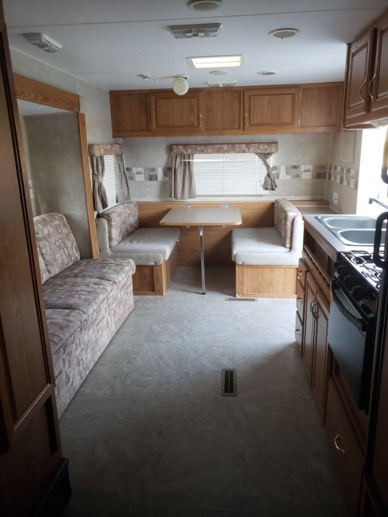 Both the sofa and dinette turns into beds. Fleetwood Pioneer 2006