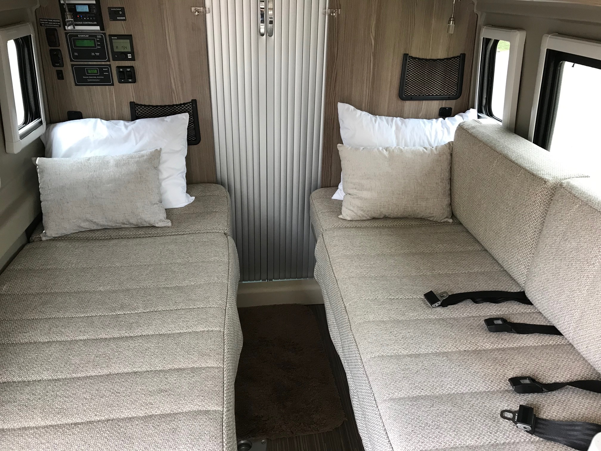 one side has 2 extra seat belts. Winnebago Travato 59K 2020